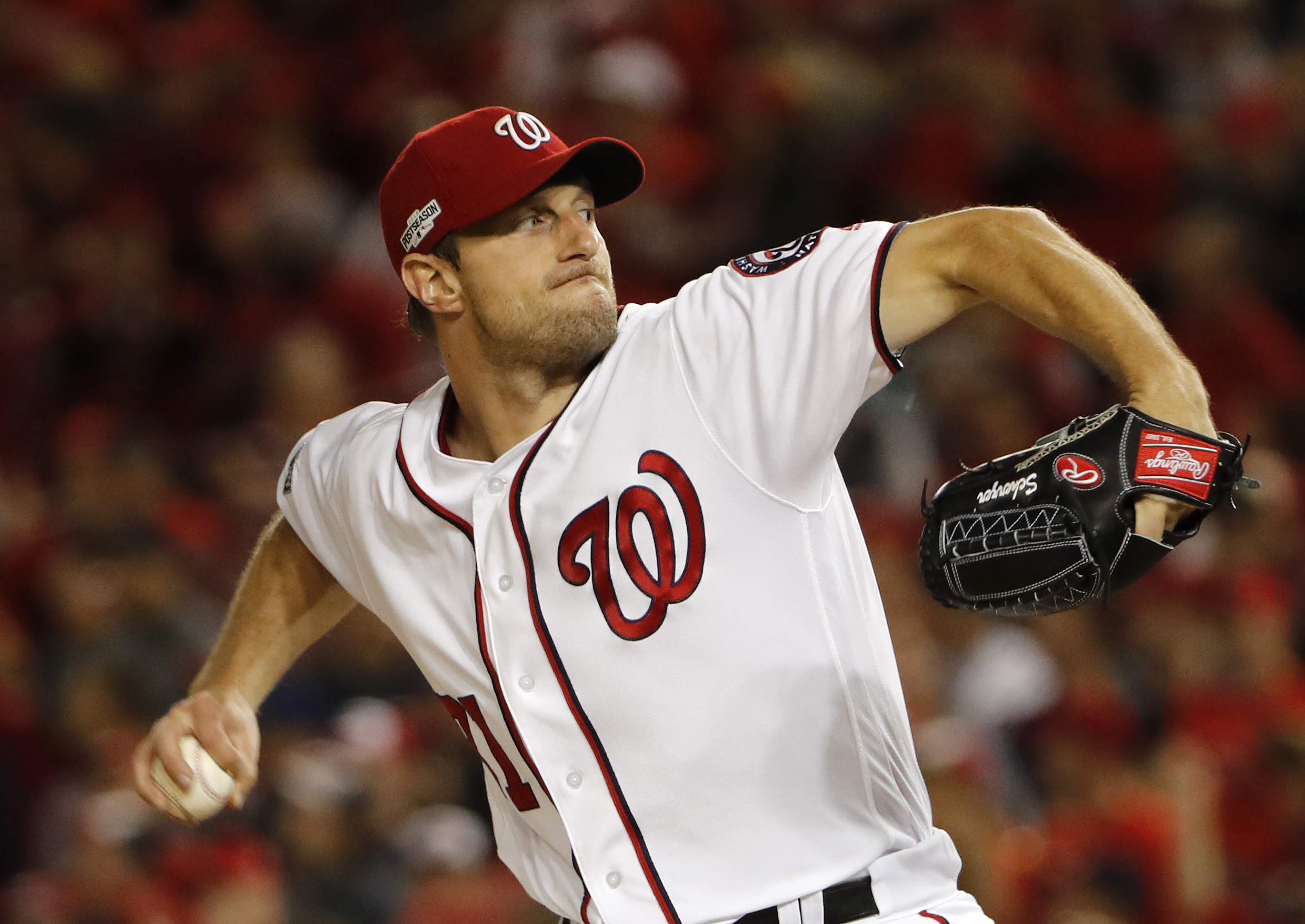 FILE - In this Oct. 13, 2016, file photo, Washington Nationals starting pitcher Max Scherzer winds up during the first inning in Game 5 of baseball's National League Division Series, against the Los Angeles Dodgers, in Washington. Scherzer, Kyle Hendricks