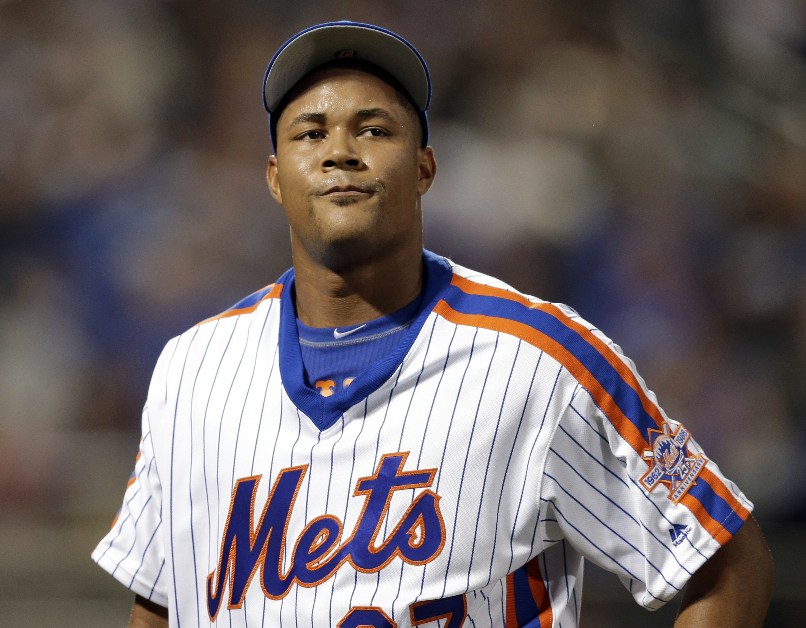 FILE - In this May 29, 2016, file photo, New York Mets relief pitcher Jeurys Familia reacts as walks off the field during the ninth inning of the baseball game against the Los Angeles Dodgers at Citi Field in New York. The wife of New York Mets pitcher Je