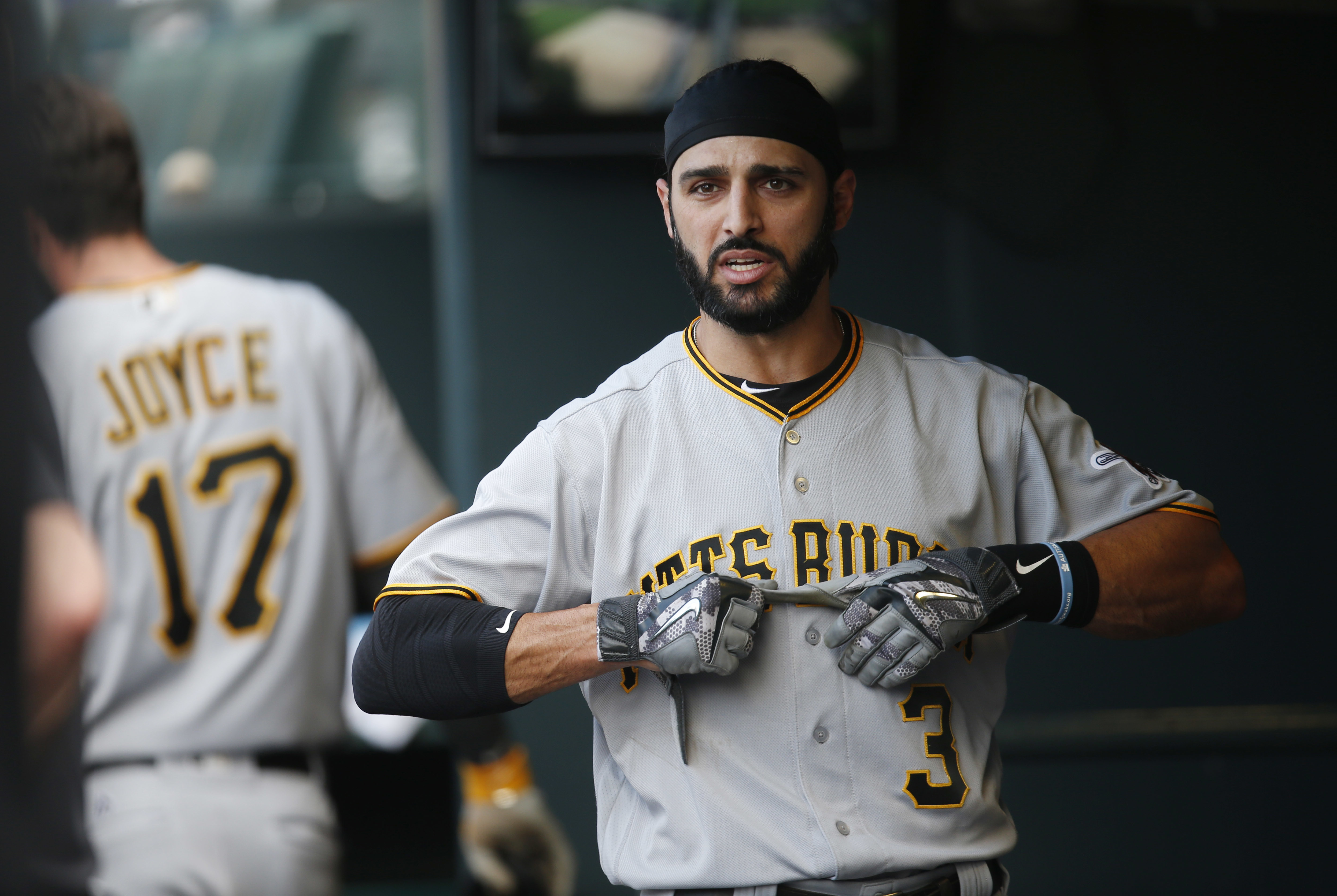 FILE - Int his June 9, 2016 photo, Pittsburgh Pirates' Sean Rodriguez pulls off his batting gloves after striking out against Colorado Rockies during the ninth inning of a baseball game in Denver. A person familiar with the situation says the Atlanta Brav