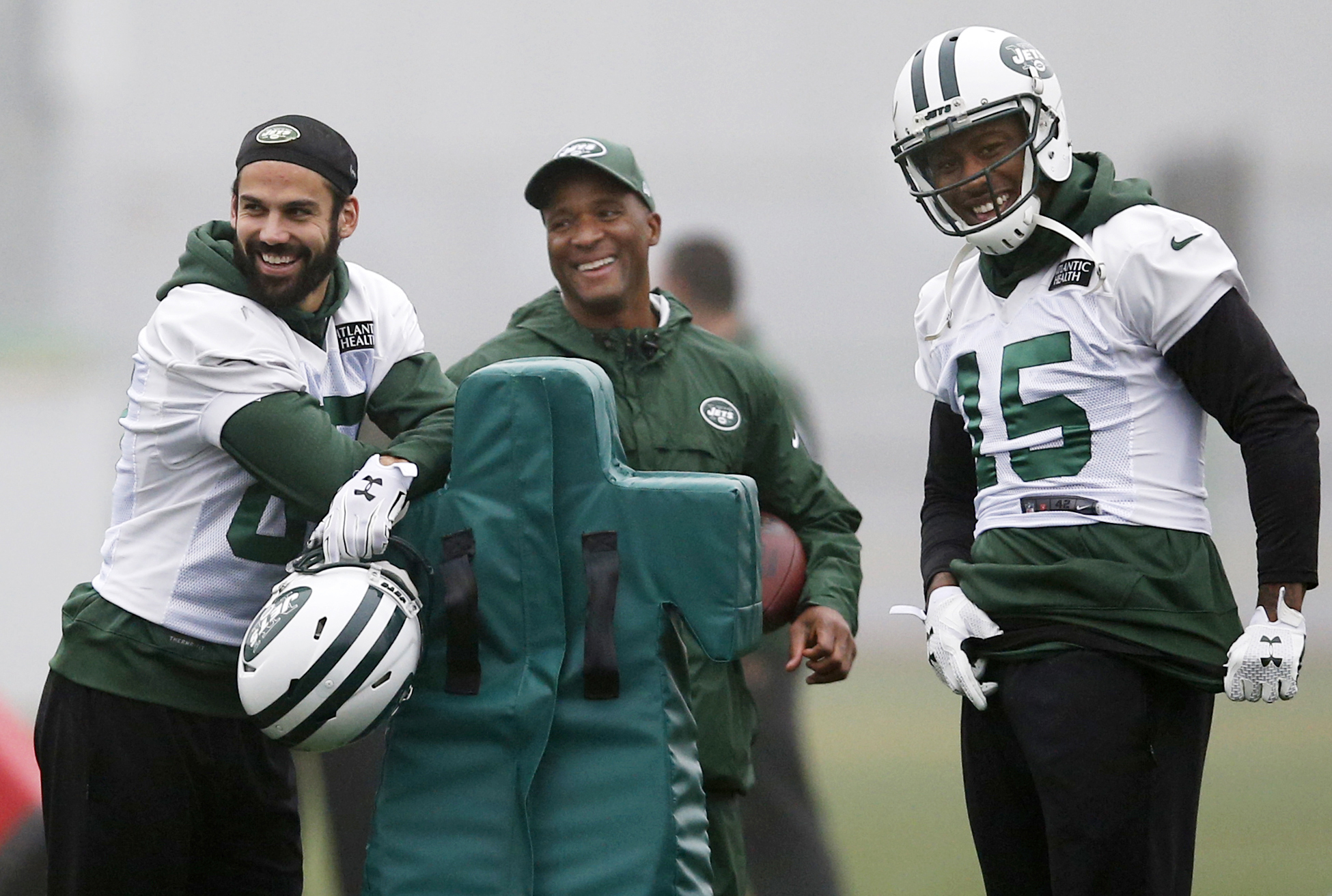 New York Jets wide receivers Eric Decker, left, and Brandon Marshall (15) and wide receivers coach Carl Dorrell share a laugh before NFL football practice, Wednesday, Dec. 30, 2015, in Florham Park, N.J.   The Jets are preparing for Sunday's game against