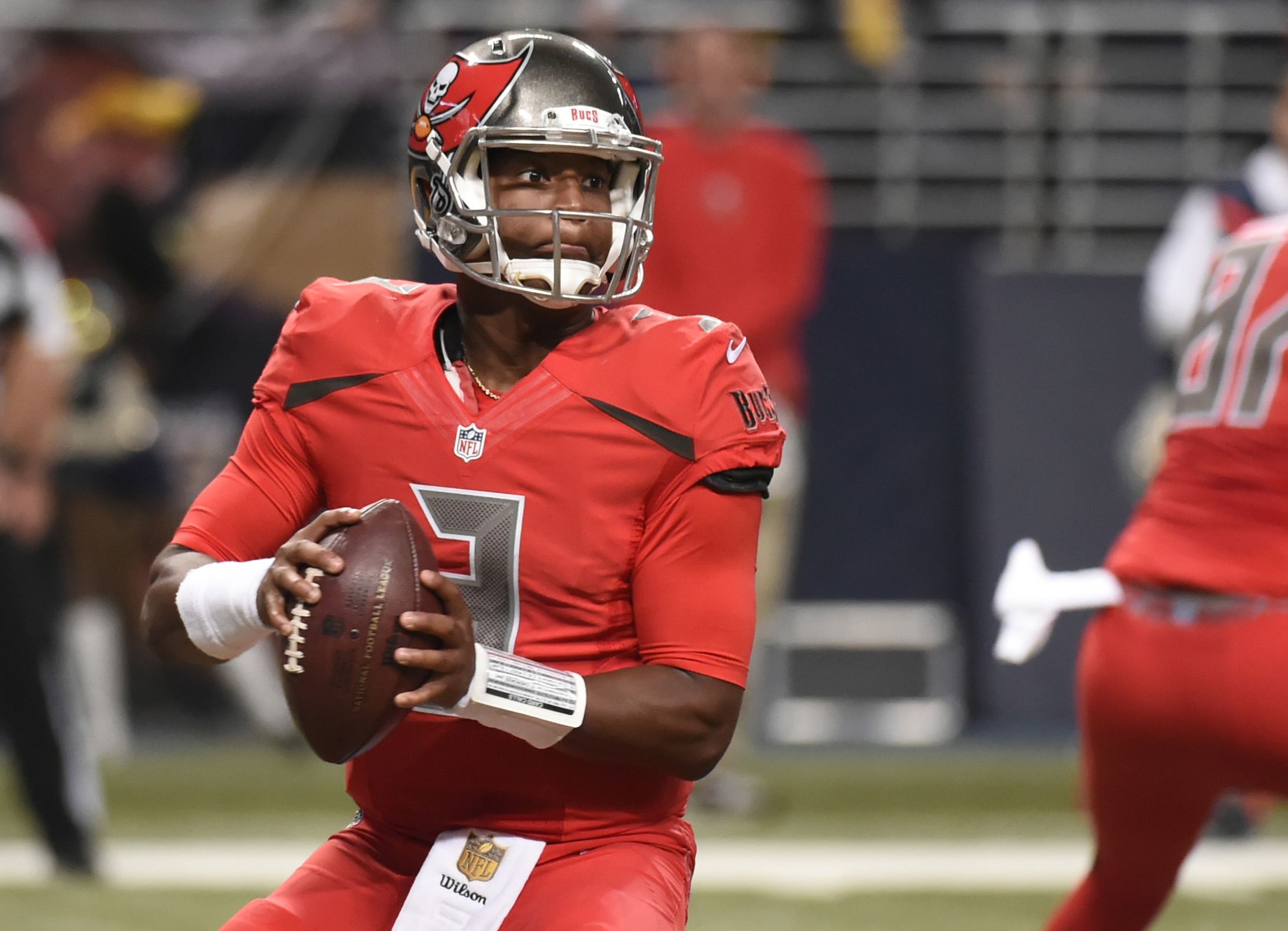 FILE - In this Dec. 17, 2015, file photo, Tampa Bay Buccaneers quarterback Jameis Winston drops back to pass during the second quarter of an NFL football game against the St. Louis Rams in St. Louis. Winston will finish his rookie season doing something t