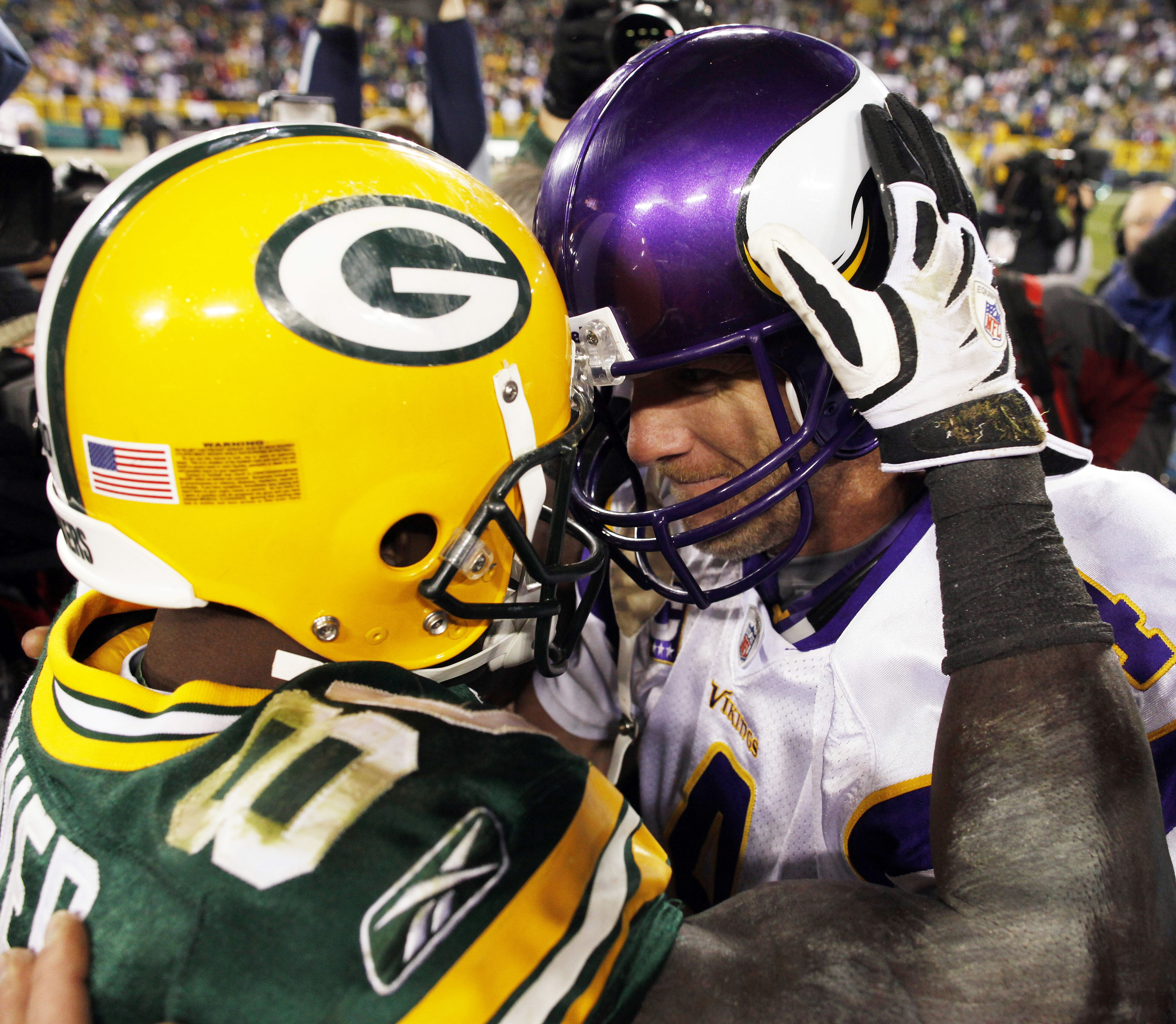 FILE - In this Nov. 1, 2009, file photo, Minnesota Vikings quarterback Brett Favre, right, and Green Bay Packers' Donald Driver put their helmets together and embrace after the Vikings defeated the Packers 38-26 in an NFL football game in Green Bay, Wis.