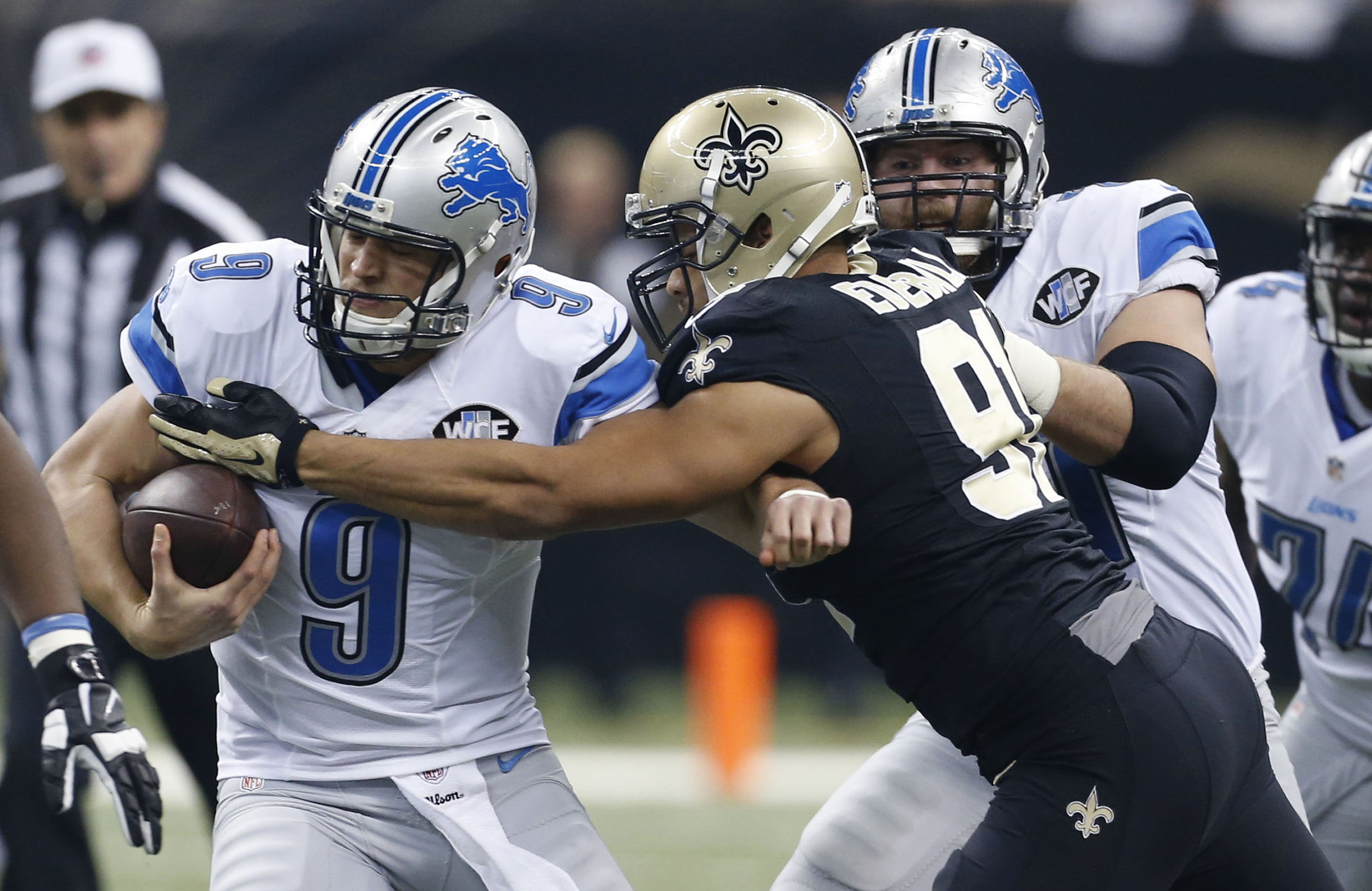 FILE - In this Dec. 21, 2015, file photo, Detroit Lions quarterback Matthew Stafford (9) is sacked by New Orleans Saints outside linebacker Kasim Edebali (91) during the first half of an NFL football game in New Orleans. A decade ago Edebali was a teenage