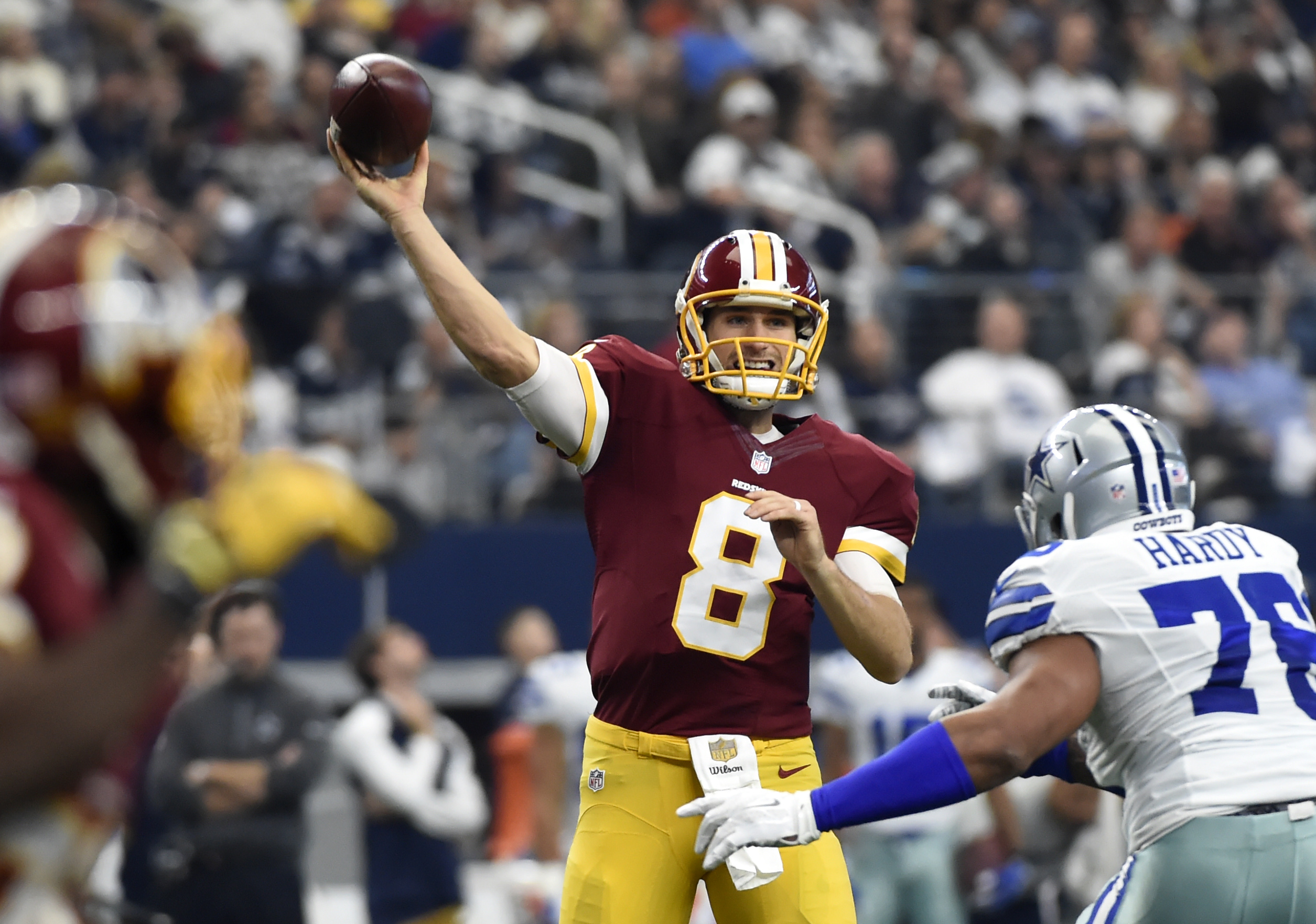Washington Redskins quarterback Kirk Cousins (8) looks to throw a pass under pressure from Dallas Cowboys defensive end Greg Hardy (76) in the first half of an NFL football game, Sunday, Jan. 3, 2016, in Arlington, Texas. (AP Photo/Michael Ainsworth)