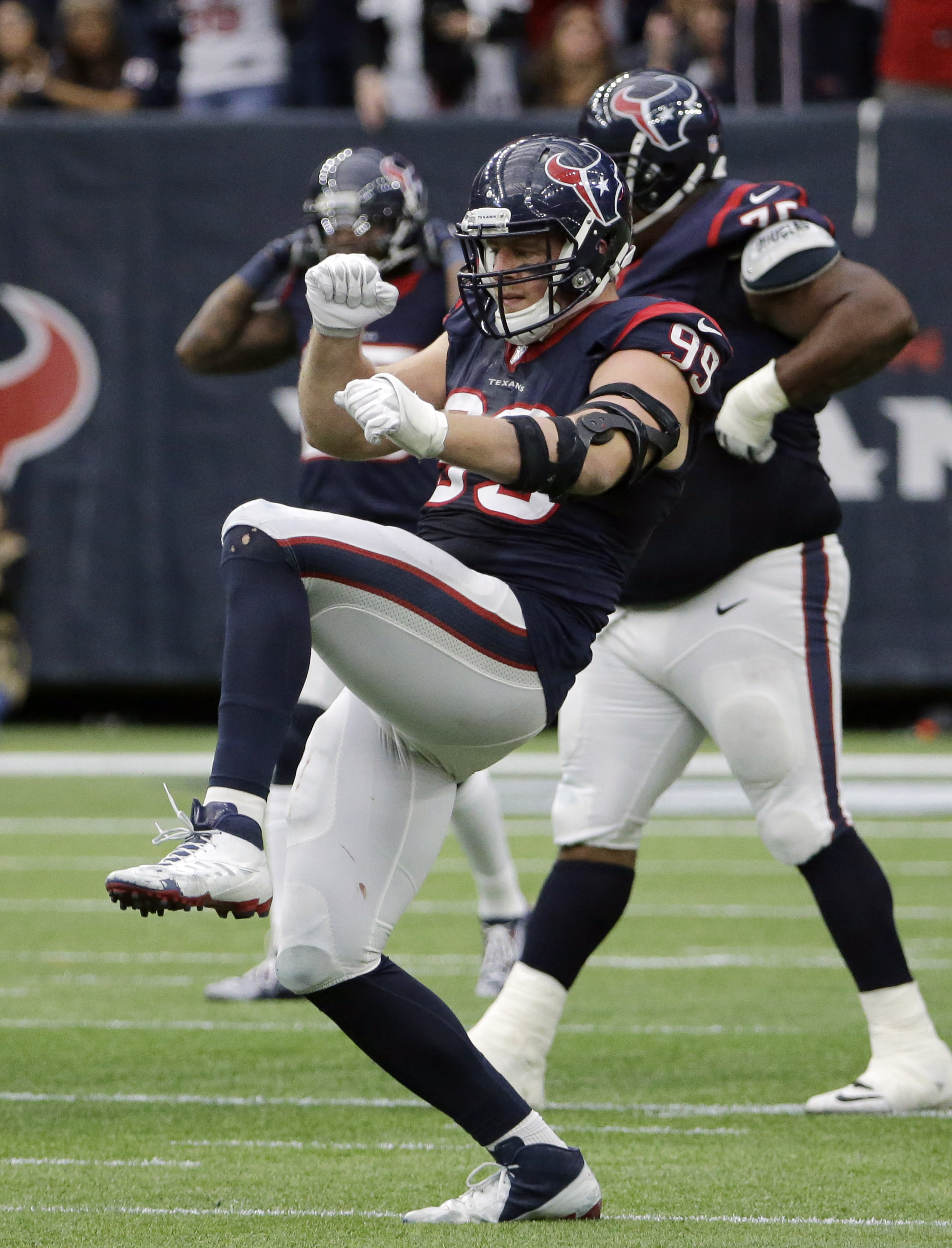 Houston Texans defensive end J.J. Watt (99) celebrates after he cause Jacksonville Jaguars quarterback Blake Bortles to fumble during the second half an NFL football game Sunday, Jan. 3, 2016, in Houston. The fumble was recovered by Houston Texans outside