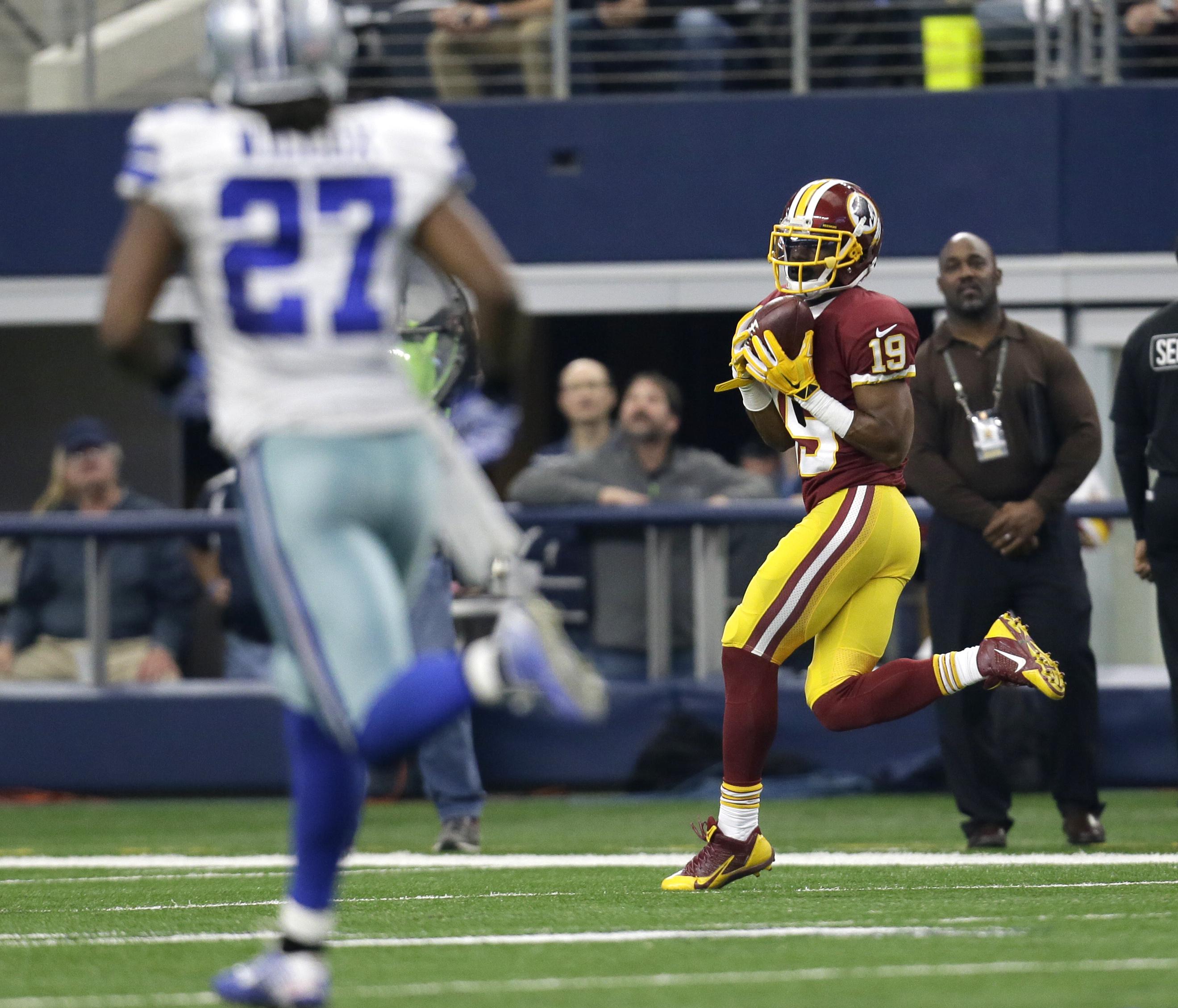 Dallas Cowboys' J.J. Wilcox (27) watches as Washington Redskins wide receiver Rashad Ross (19) catches a long pass that he ran for a touchdown in the second half of an NFL football game, Sunday, Jan. 3, 2016, in Arlington, Texas. (AP Photo/Tim Sharp)