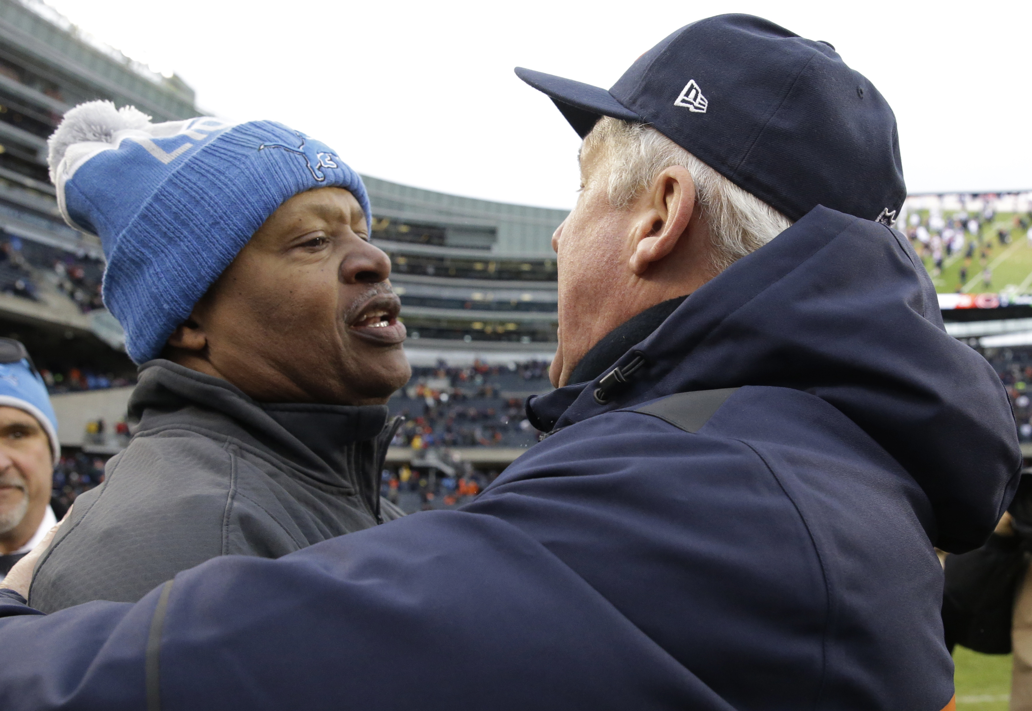 Detroit Lions head coach Jim Caldwell talks to Chicago Bears head coach John Fox after an NFL football game, Sunday, Jan. 3, 2016, in Chicago. The Lions won 24-20. (AP Photo/Nam Y. Huh)