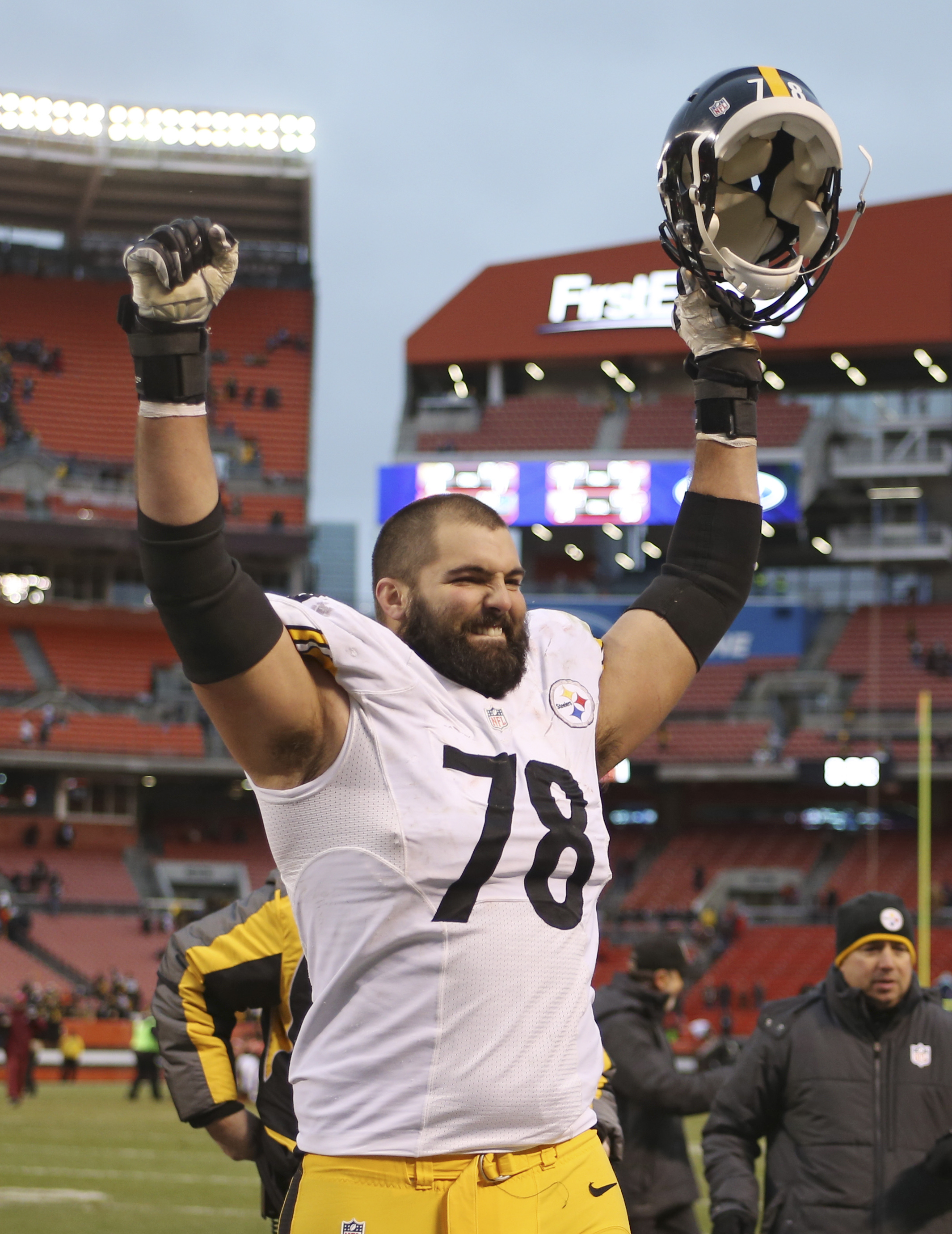 Pittsburgh Steelers tackle Alejandro Villanueva celebrates after the Steelers won 28-12 during an NFL football game against the Cleveland Browns, Sunday, Jan. 3, 2016, in Cleveland. (AP Photo/Ron Schwane)