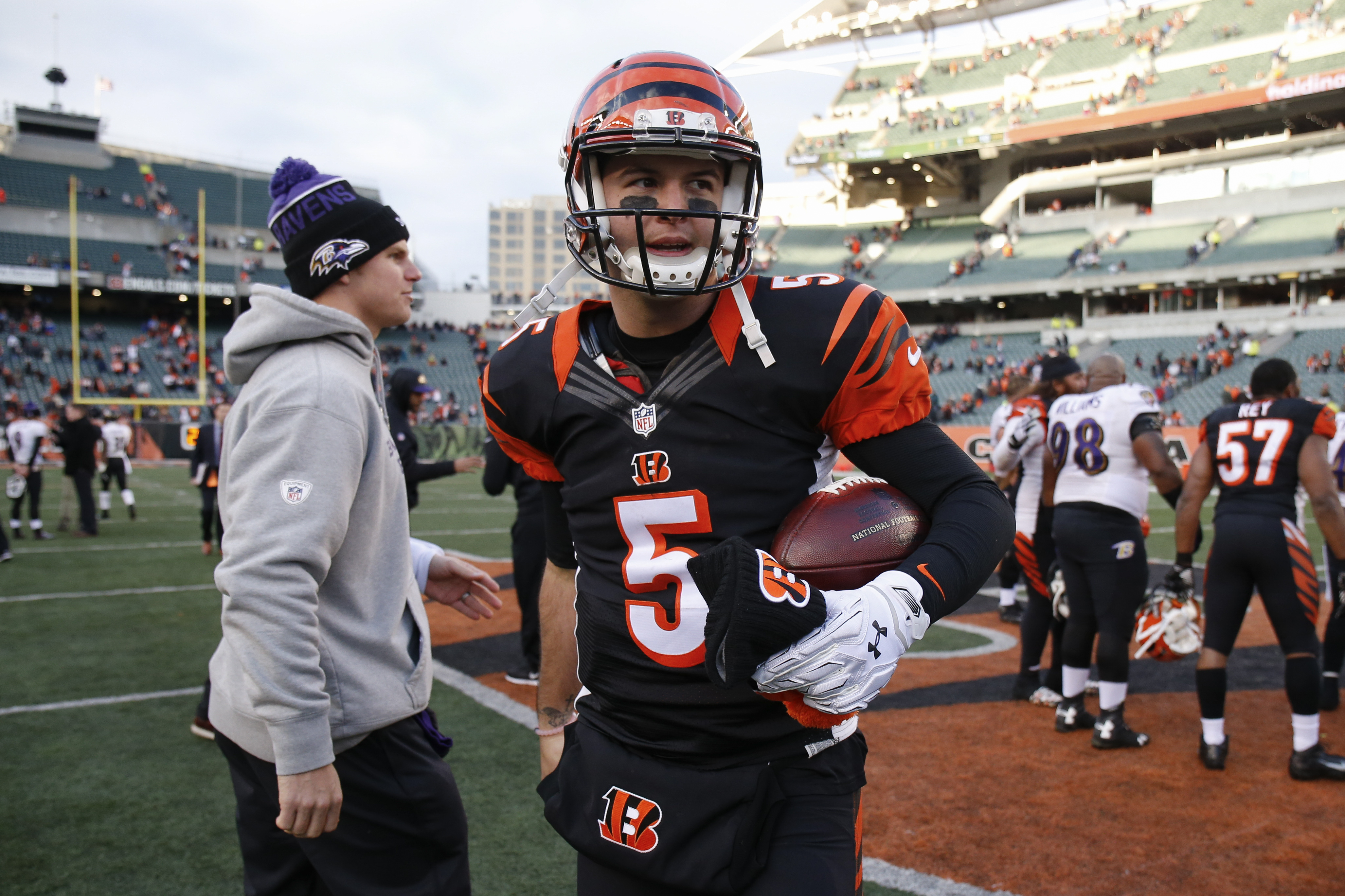 Cincinnati Bengals quarterback AJ McCarron (5) walks the field after an NFL football game against the Baltimore Ravens, Sunday, Jan. 3, 2016, in Cincinnati. Cincinnati won 24-16. (AP Photo/Gary Landers)