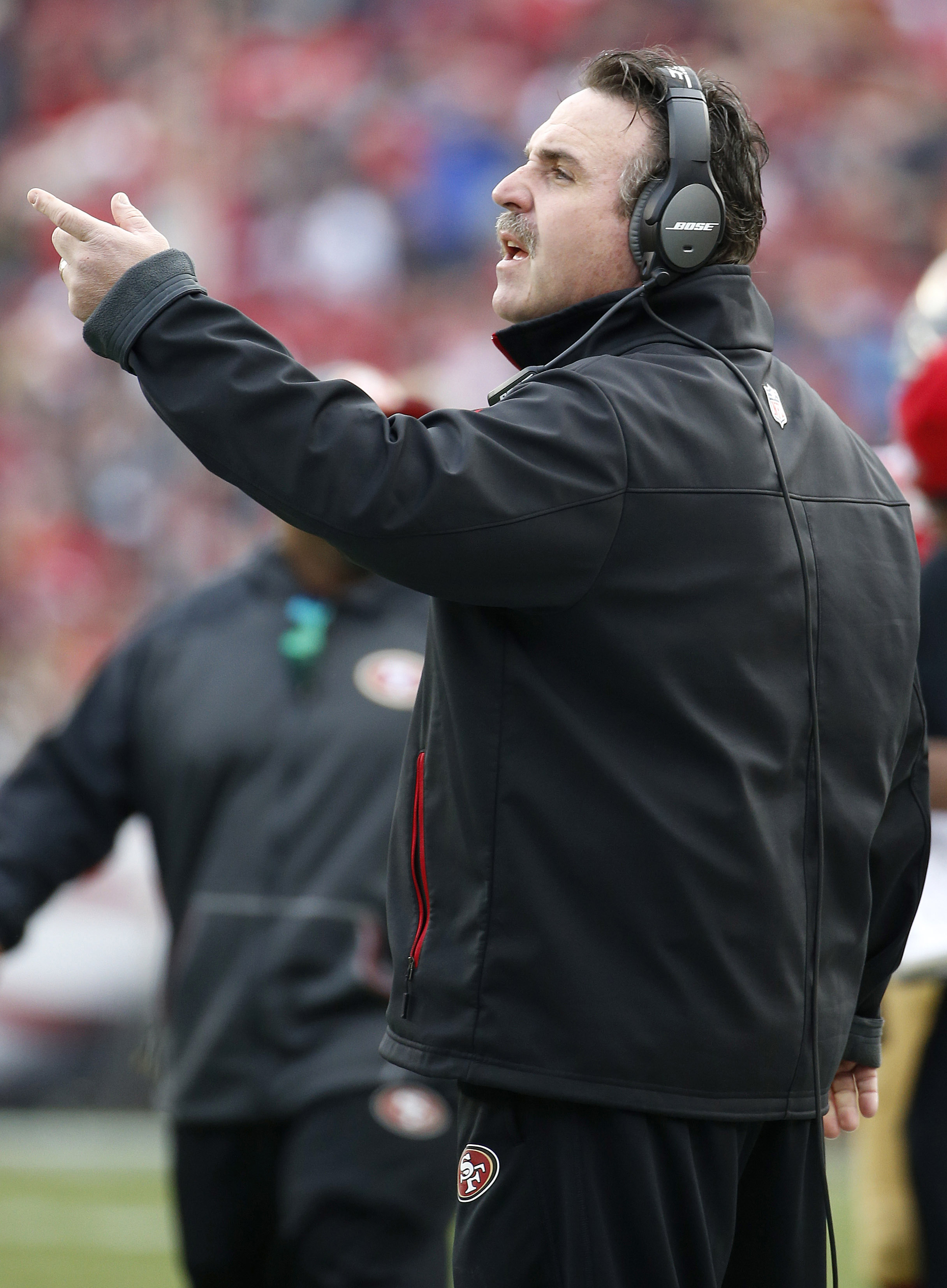 San Francisco 49ers head coach Jim Tomsula gestures during the first half of an NFL football game between the 49ers and the St. Louis Rams in Santa Clara, Calif., Sunday, Jan. 3, 2016. (AP Photo/Tony Avelar)