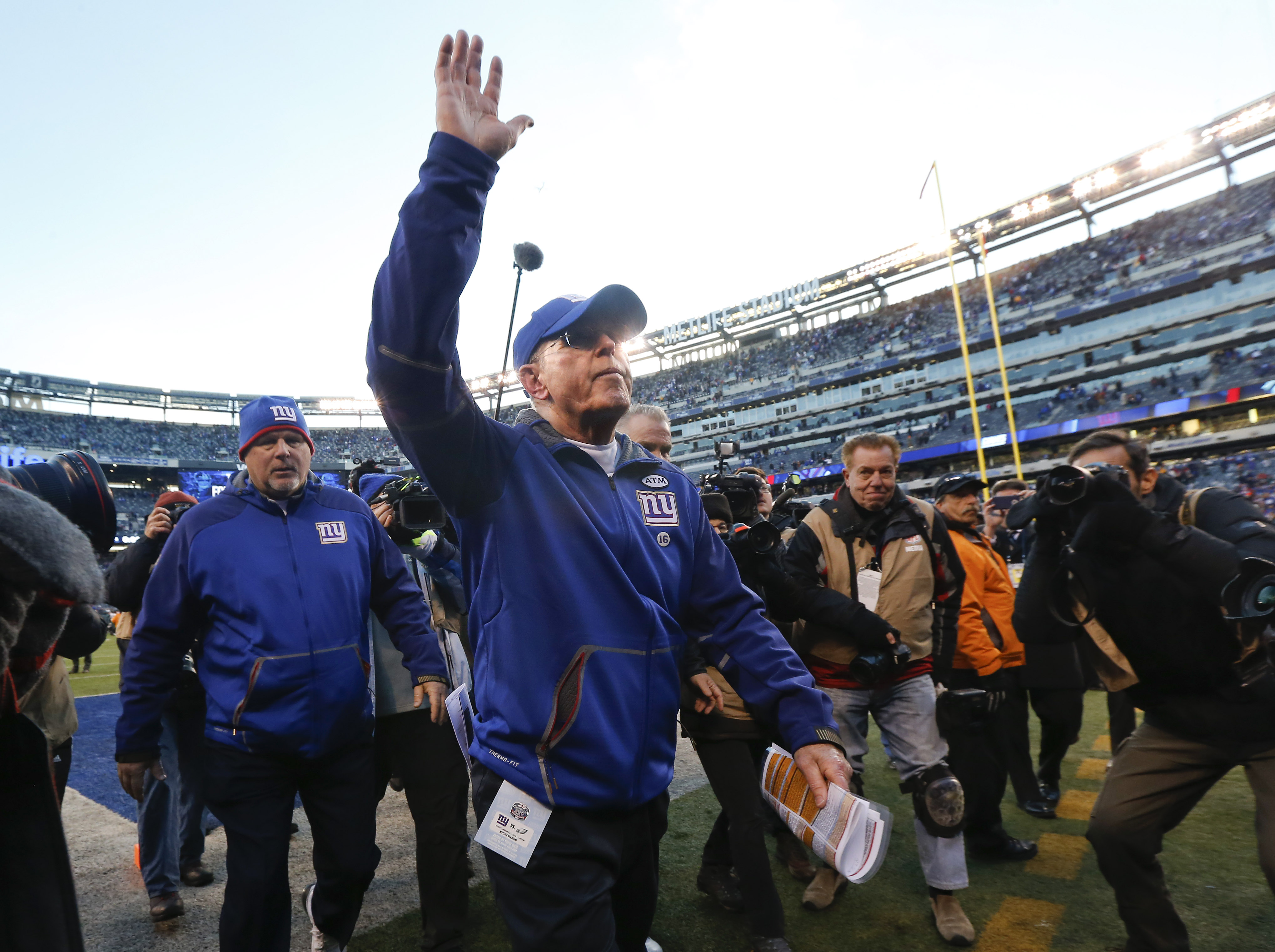 New York Giants head coach Tom Coughlin walks off the field after the Giants lost 35-30 to the Philadelphia Eagles in an NFL football game, Sunday, Jan. 3, 2016, in East Rutherford, N.J. (AP Photo/Julio Cortez)