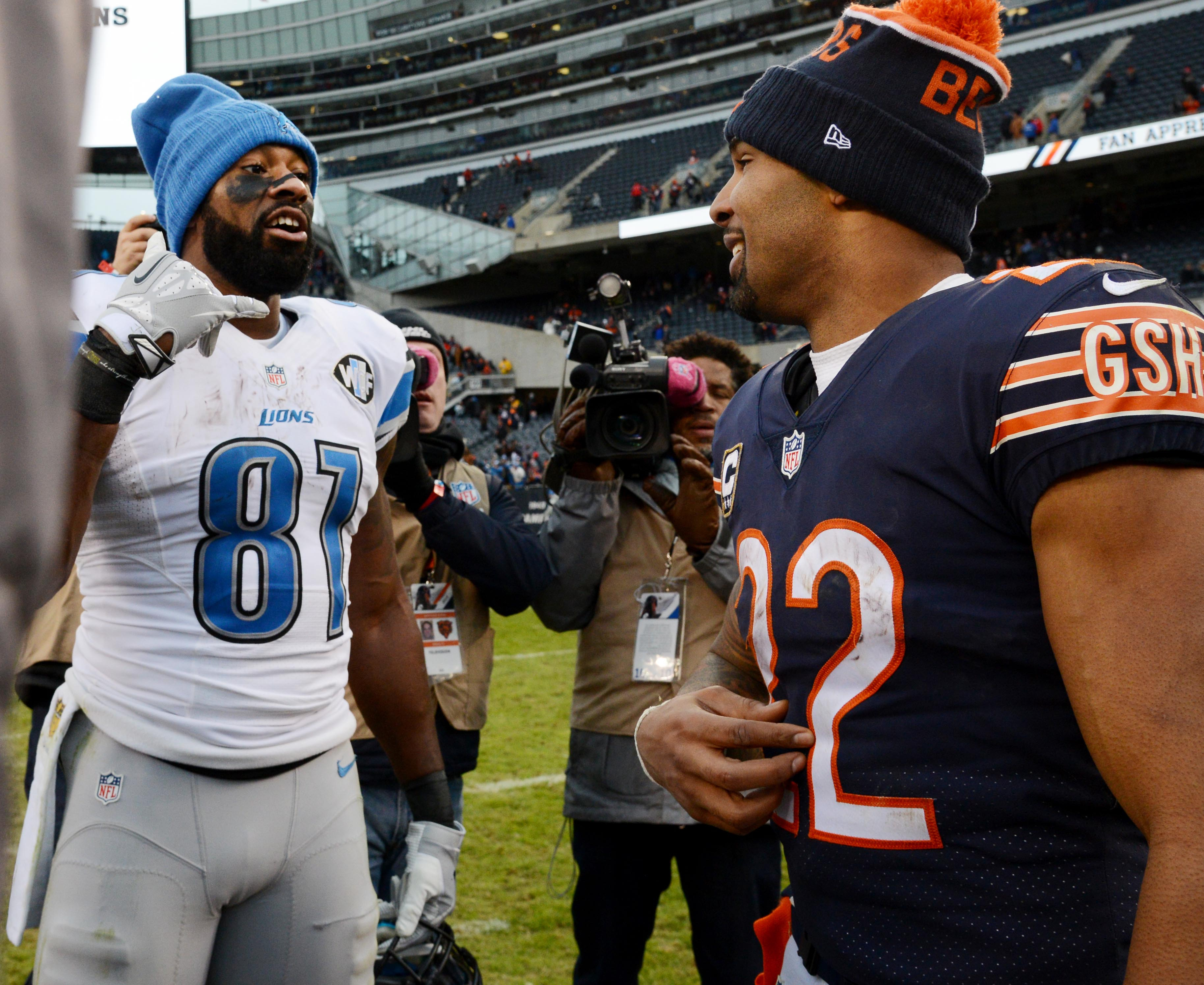 Chicago Bears running back Matt Forte and Detroit Lions wide receiver Calvin Johnson talks about getting together during the off season after an NFL football game, Sunday, Jan. 3, 2016, at Soldier Field in Chicago. (John Starks/Daily Herald via AP)