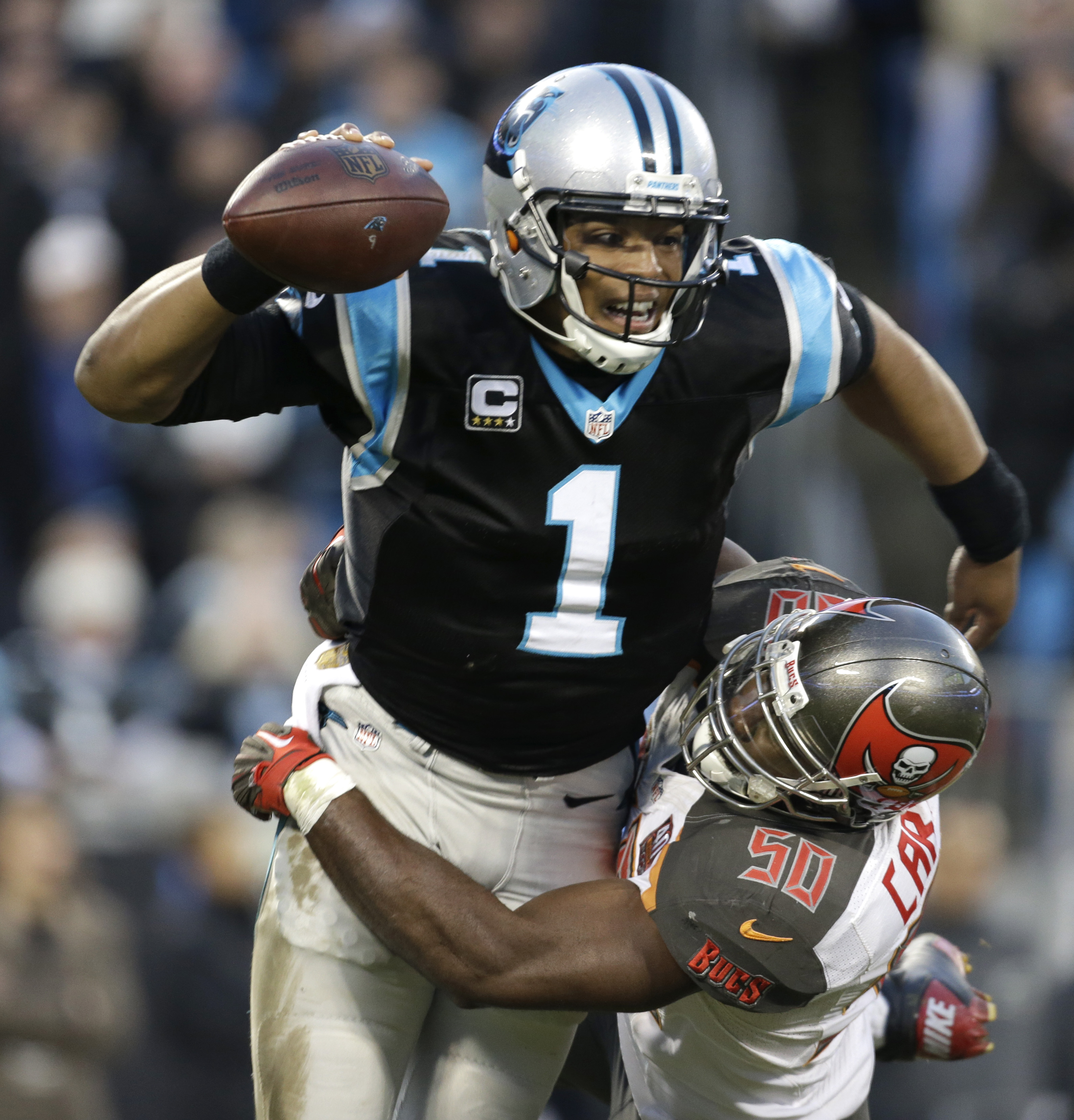 Carolina Panthers quarterback Cam Newton (1) is sacked by Tampa Bay Buccaneers linebacker Bruce Carter (50) in the first half of an NFL football game in Charlotte, N.C., Sunday, Jan. 3, 2016. (AP Photo/Bob Leverone)