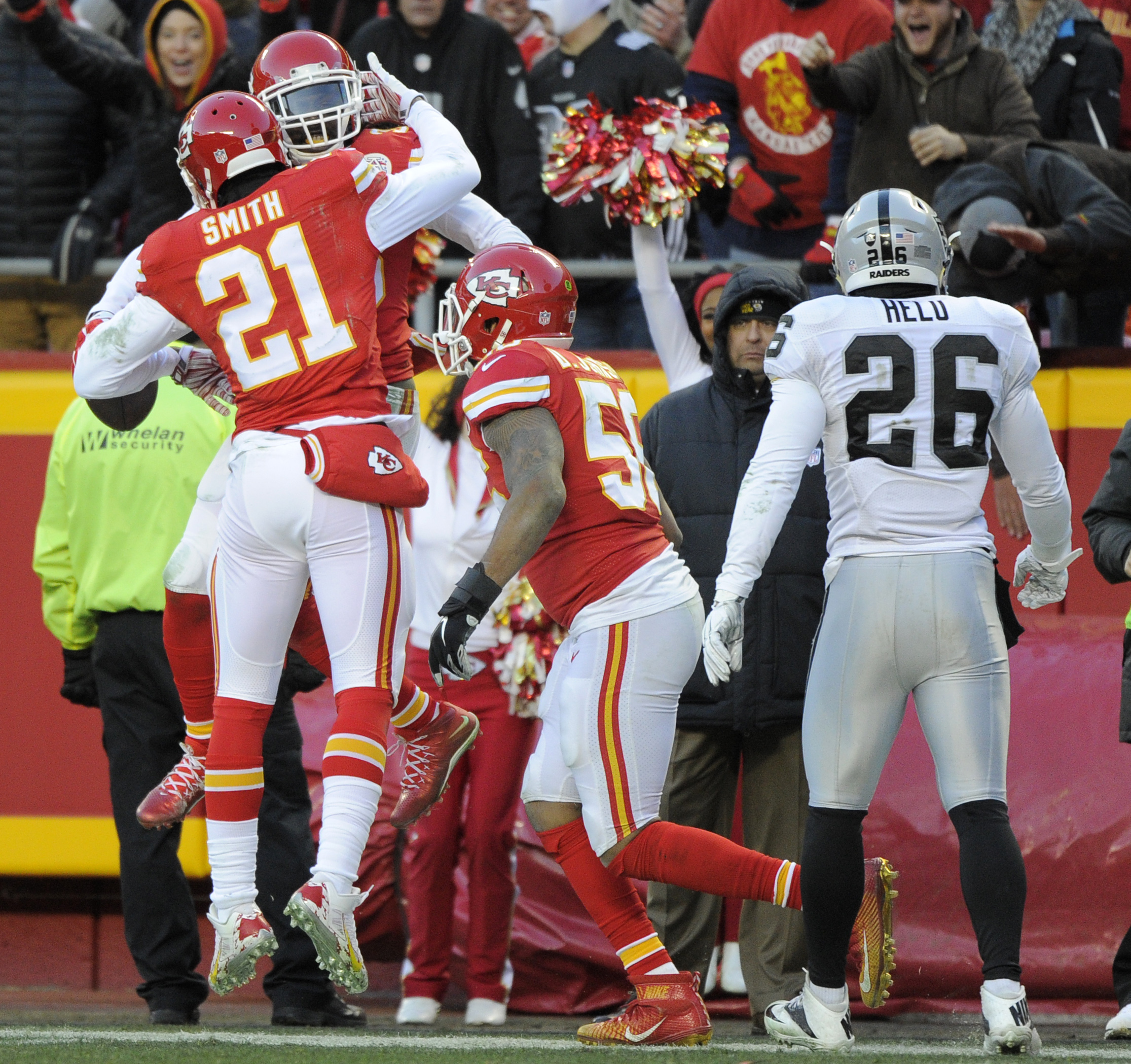 Kansas City Chiefs linebacker Derrick Johnson, right, and cornerback Sean Smith (21) celebrate with safety Ron Parker (38) after an interception by Parker during the first half of an NFL football game against the Oakland Raiders in Kansas City, Mo., Sunda