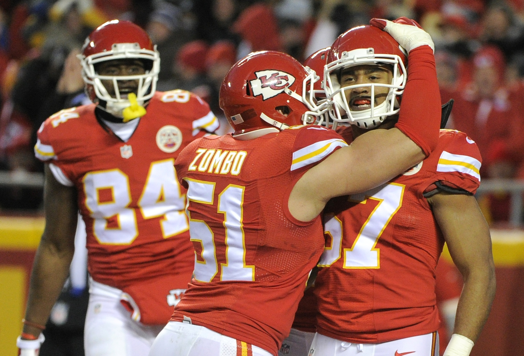 Kansas City Chiefs linebacker Frank Zombo (51) hugs linebacker D.J. Alexander (57) after Alexander blocked a punt by the Oakland Raiders for a safety during the second half of an NFL football game in Kansas City, Mo., Sunday, Jan. 3, 2016. (AP Photo/Ed Zu