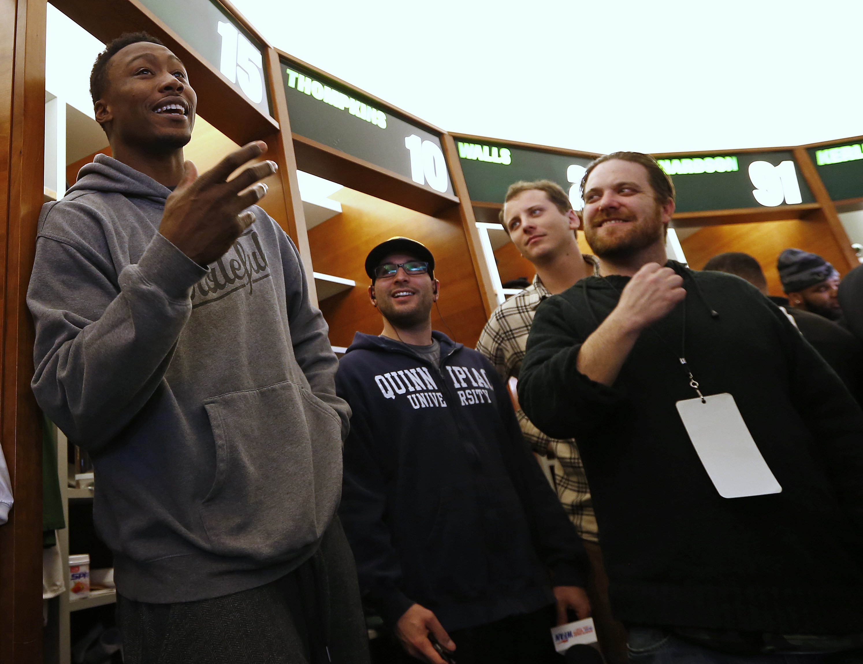 New York Jets wide receiver Brandon Marshall talks to the media as the team clears out their lockers at the team's NFL football training facility, Monday, Jan. 4, 2016, in Florham Park, N.J. (AP Photo/Rich Schultz)