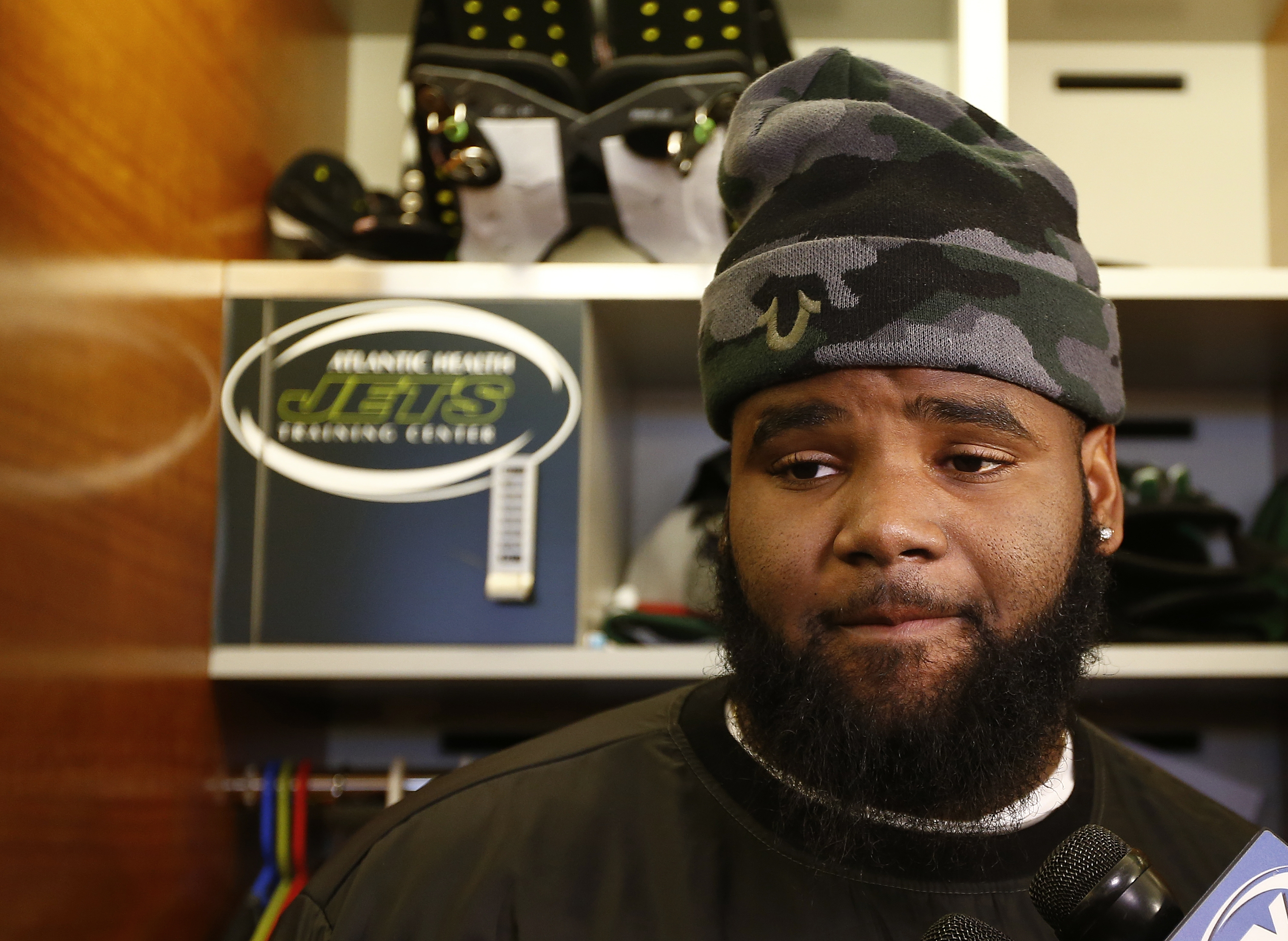 New York Jets defensive tackle Sheldon Richardson talks to the media as the team clears out their lockers at the team's NFL football training facility, Monday, Jan. 4, 2016, in Florham Park, N.J. (AP Photo/Rich Schultz)