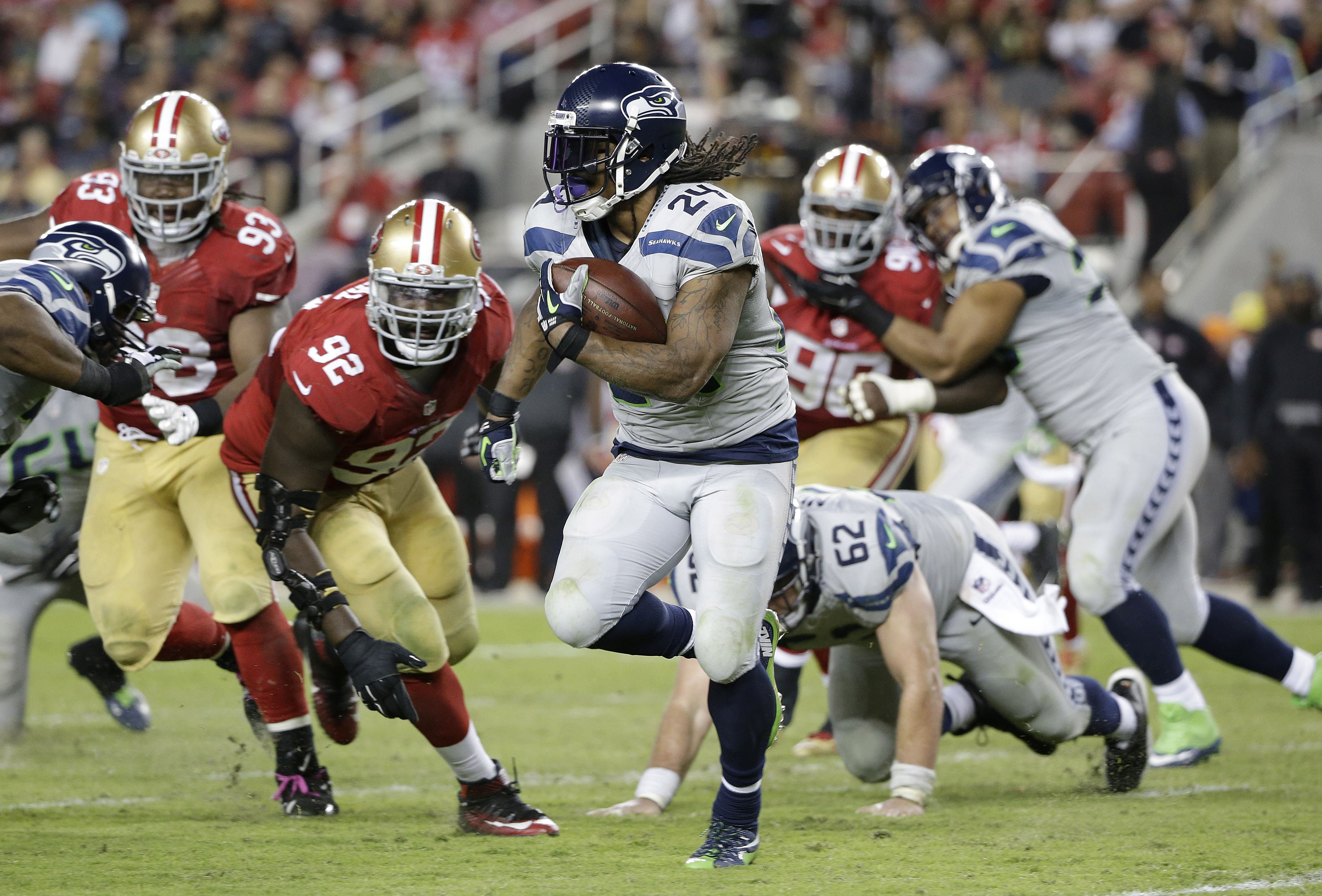 FILE - In this Oct. 22, 2015, file photo, Seattle Seahawks running back Marshawn Lynch (24) runs against San Francisco 49ers defensive end Quinton Dial (92) during the second half of an NFL football game in Santa Clara, Calif. Marshawn Lynch has rejoined