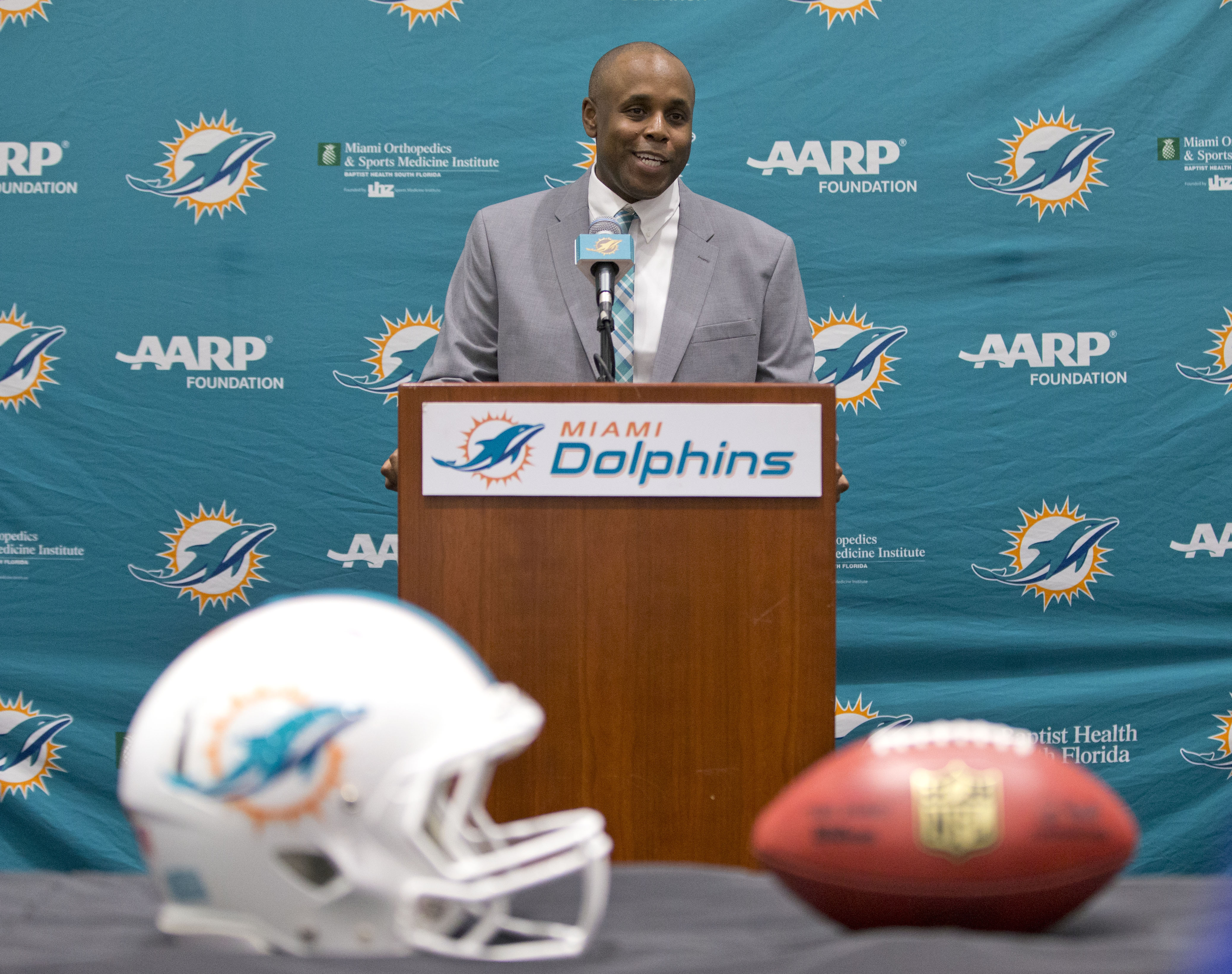 Miami Dolphins former director of college scouting, Chris Grier, smiles as he speaks to the media after being introduced as the new general manager, Monday, Jan. 4, 2016 at the Dolphins training facility in Davie, Fla. Grier replaces Dennis Hickey, whose