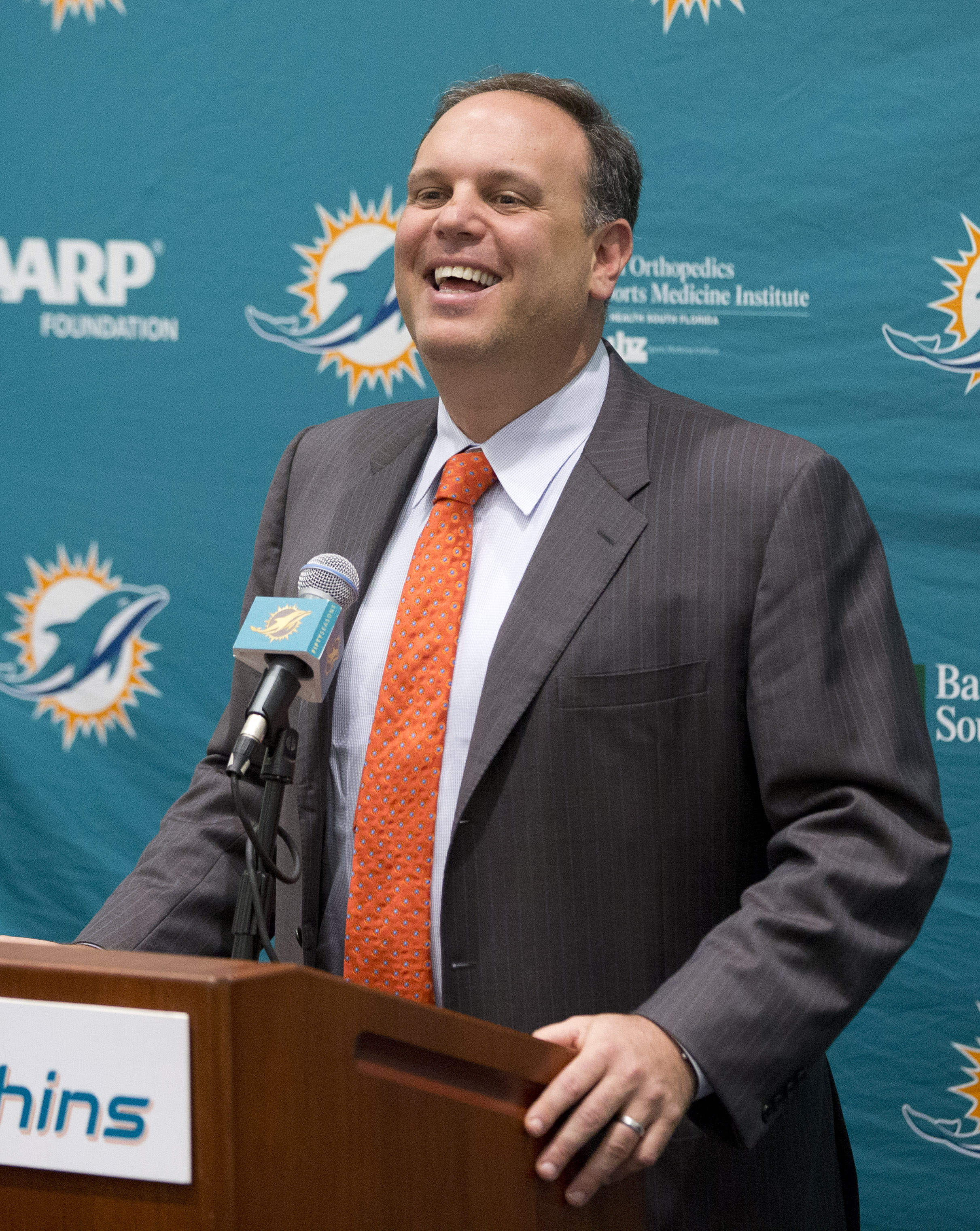 Miami Dolphins executive vice president of football operations, Mike Tannenbaum, laughs as he speaks to members of the media, Monday, Jan. 4, 2016 at the Dolphins training facility in Davie, Fla. Tannenbaum announced the hiring of former Dolphins director