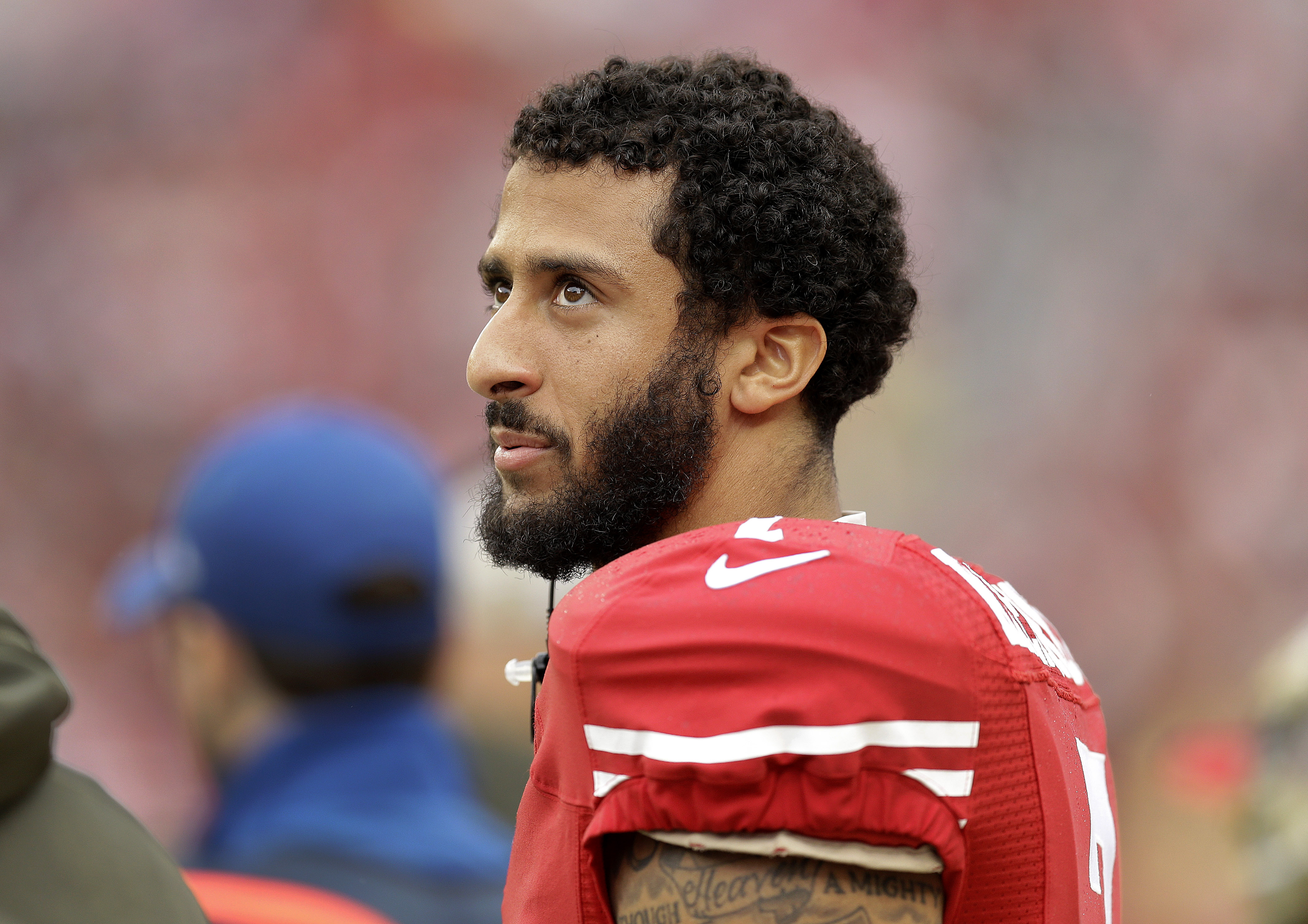 FILE - In this Nov. 8, 2015, file photo, San Francisco 49ers quarterback Colin Kaepernick (7) stands on the sideline during the first half of an NFL football game against the Atlanta Falcons in Santa Clara, Calif. 49ers quarterback Colin Kaepernick has a