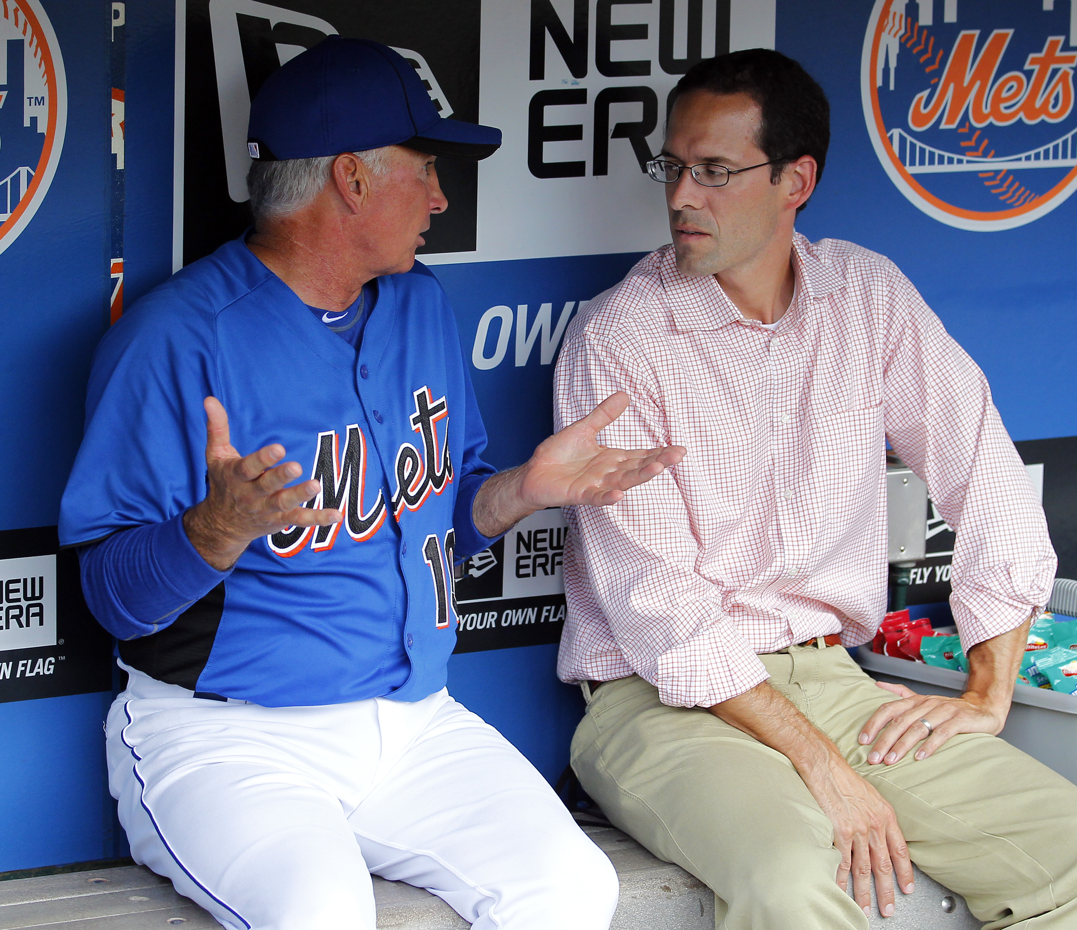 New York Mets manager Terry Collins talks with Mets VP of Player Development Paul DePodesta in the dugout before the game against the San Diego Padres in New York, Monday, Aug. 8, 2011. (AP Photo/Paul J. Bereswill)