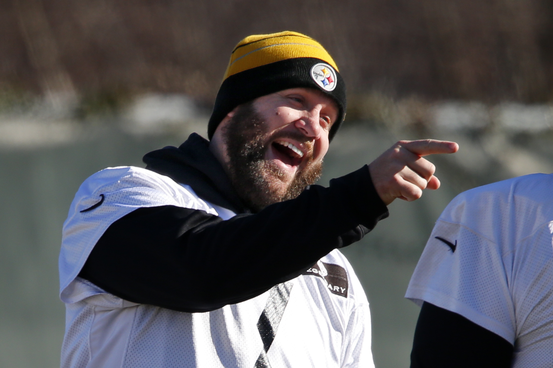 Pittsburgh Steelers quarterback Ben Roethlisberger shares a laugh with a teammate while warming up during an NFL football practice, in Pittsburgh, Wednesday, Jan. 6, 2016. The Steelers face the Cincinnati Bengals in an NFL Wild Card playoff football game
