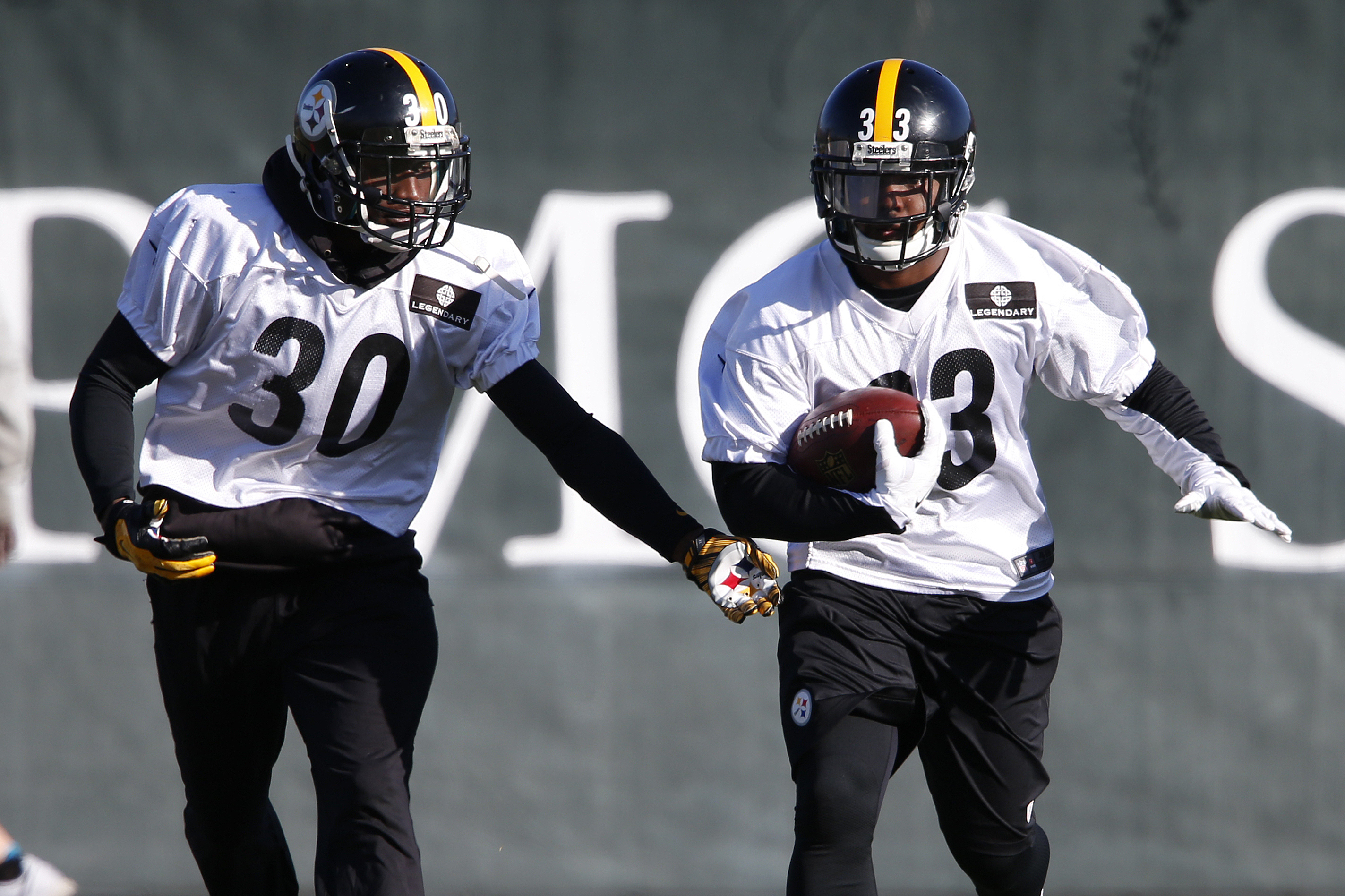 Pittsburgh Steelers running backs Fitzgerald Toussaint (33) and Jordan Todman (30) run a drill during an NFL football practice, in Pittsburgh, Wednesday, Jan. 6, 2016. With starting running back DeAngelo Williams' right foot still hurting, Toussaint and T