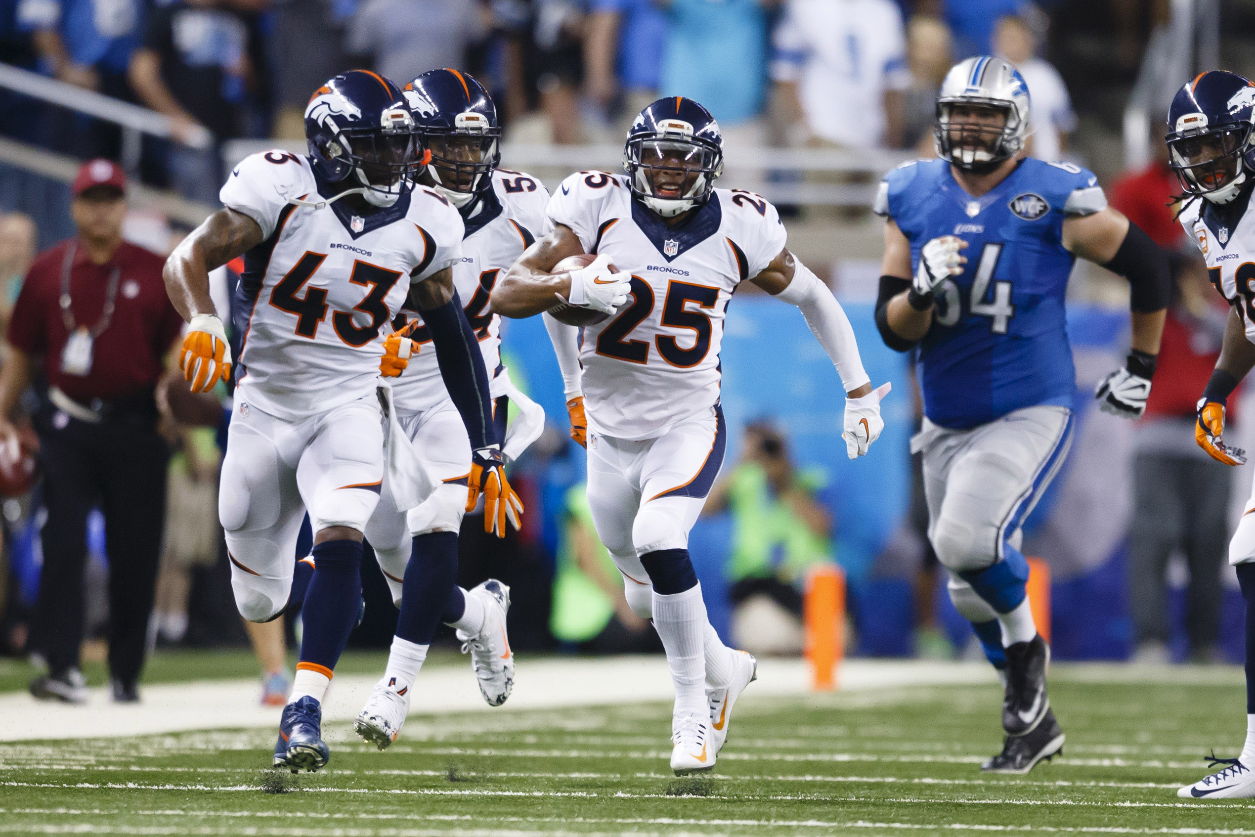 FILE - In this Sept. 27, 2015 file photo, Denver Broncos cornerback Chris Harris (25) runs the ball after a blocked extra point attempt against the Detroit Lions during an NFL football game at Ford Field in Detroit. Denver's defense, which finished No. 1