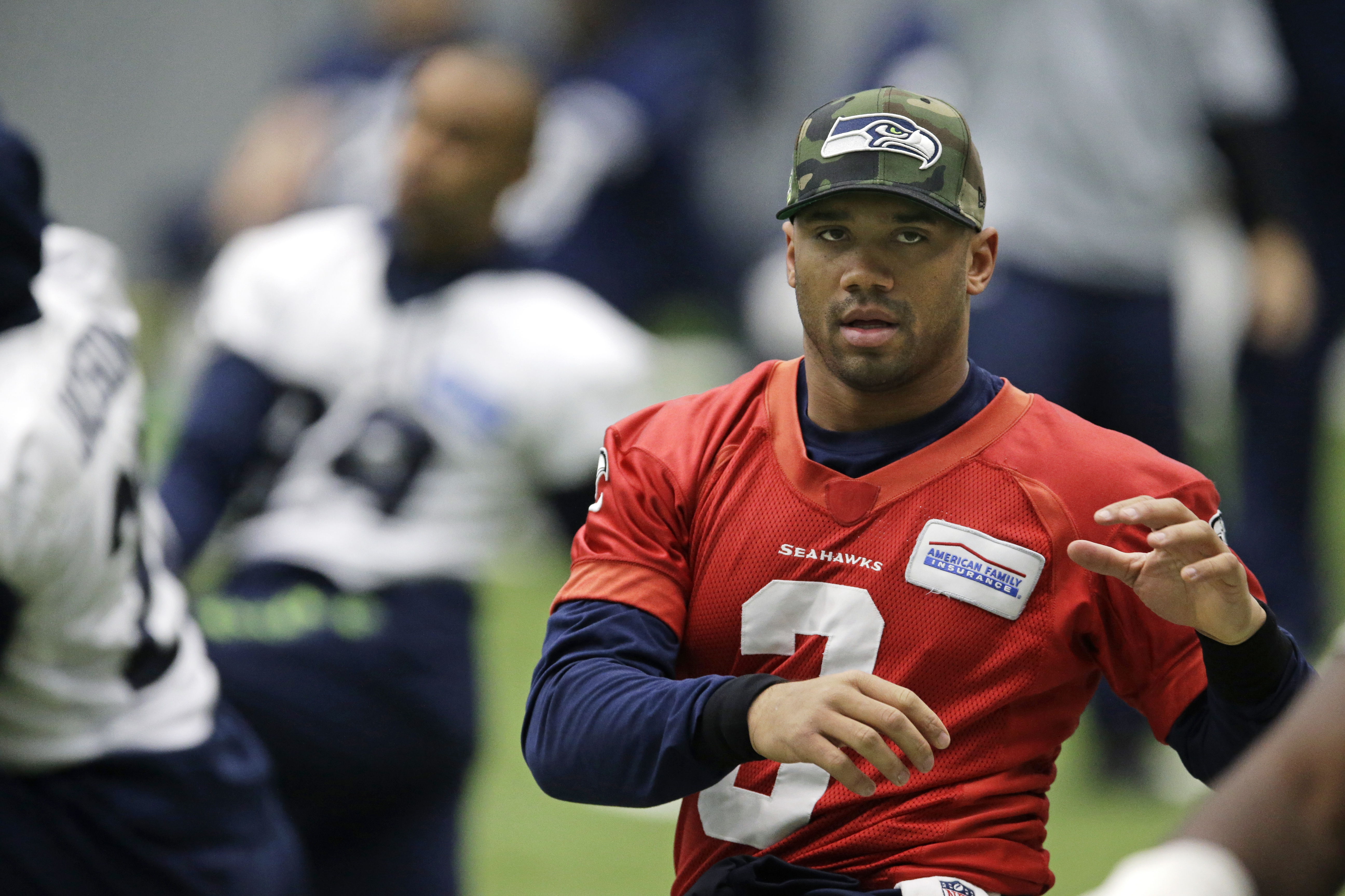 Seattle Seahawks quarterback Russell Wilson warms up before NFL football practice, Wednesday, Jan. 6, 2016, in Renton, Wash. (AP Photo/Ted S. Warren)