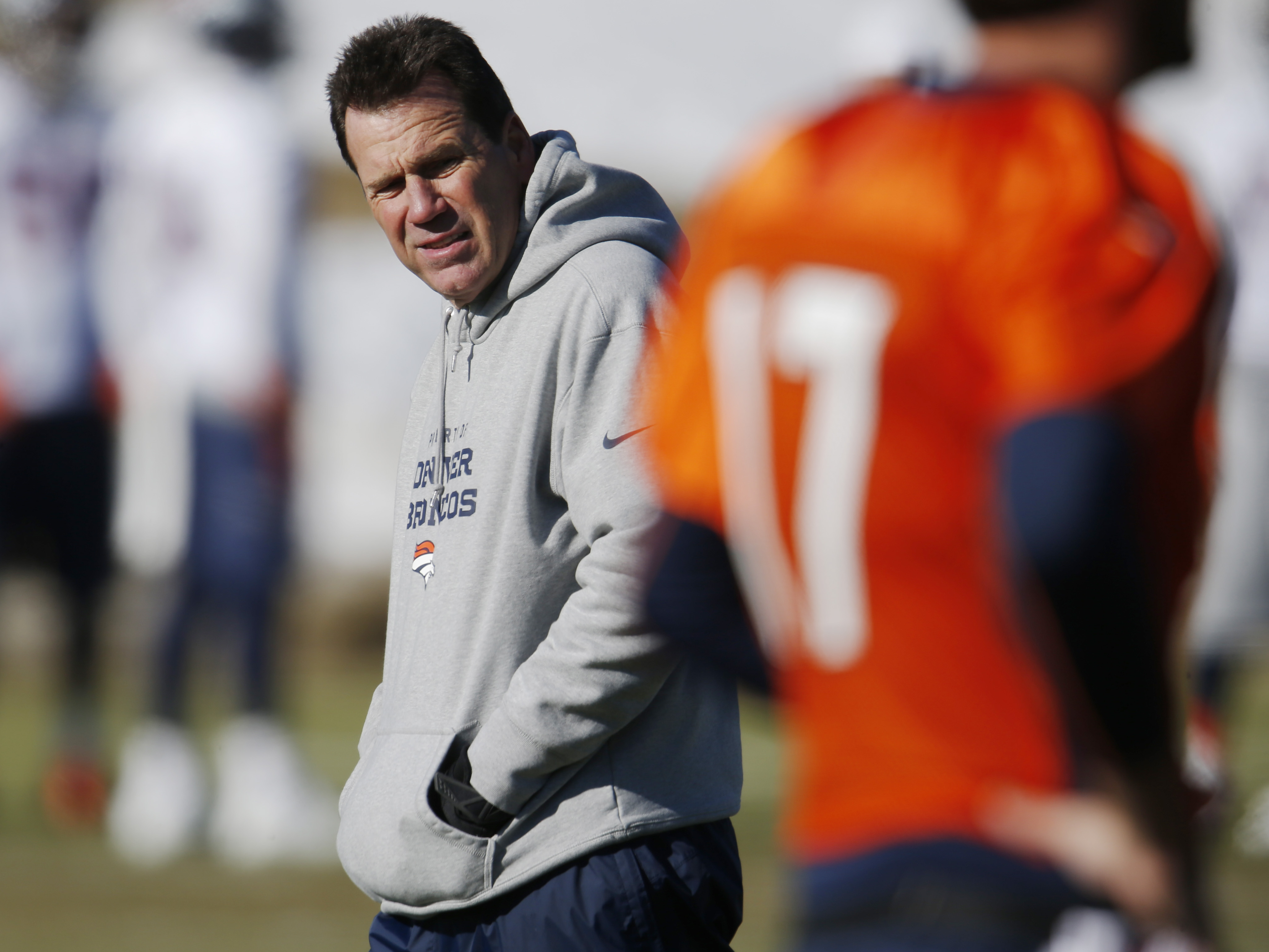 FILE - In this Dec. 23, 2015, file photo, Denver Broncos head coach Gary Kubiak, back, casts ay eye toward quarterback Brock Osweiler during an NFL football practice in Englewood, Colo.  The Broncos settled on quarterback Peyton Manning. Certainly, Bronco