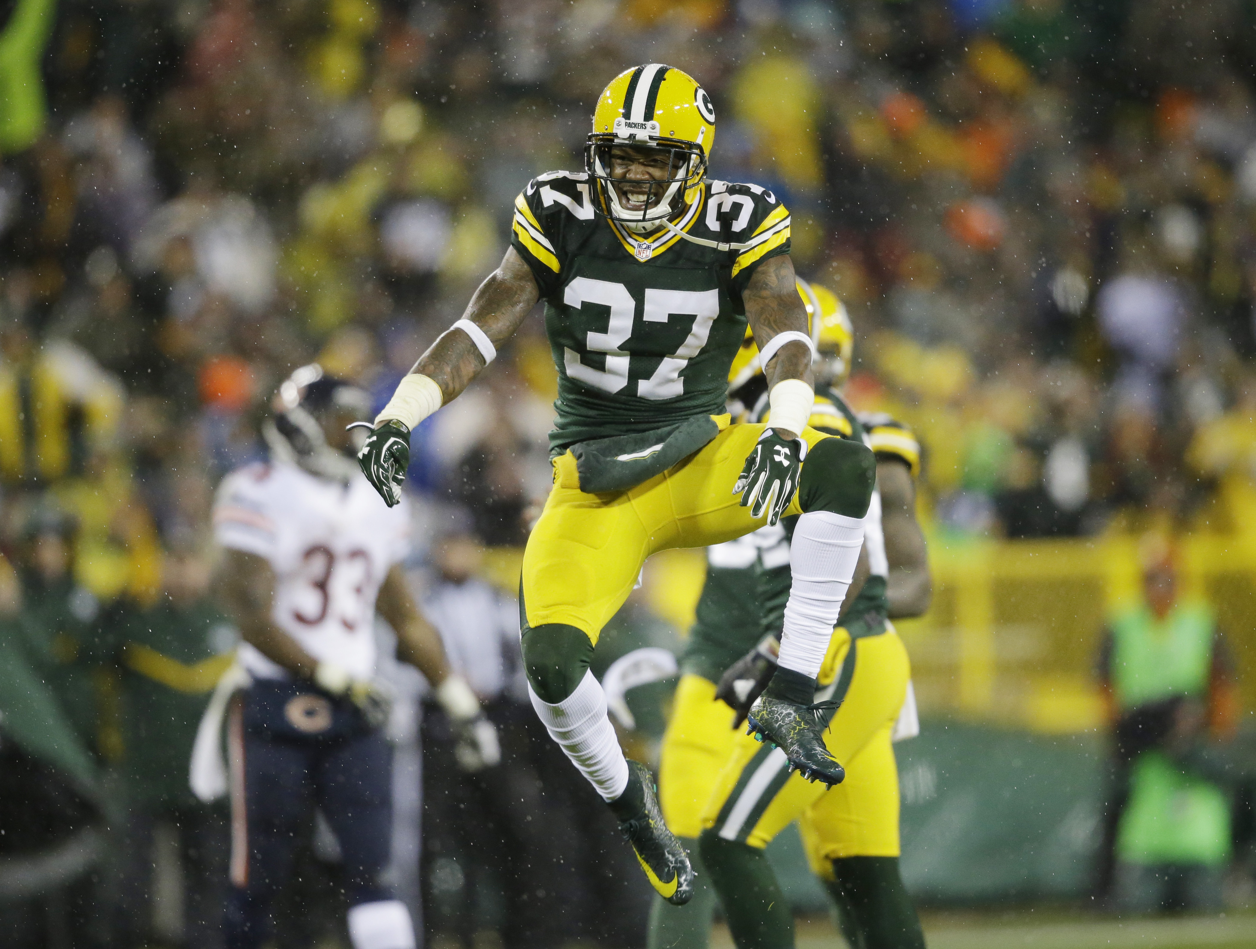 FILE - In this Nov. 26, 2015, file photo, Green Bay Packers' Sam Shields celebrates his teammate Quinten Rollins' sack of Chicago Bears quarterback Jay Cutler during the second half of an NFL football game, in Green Bay, Wis. Well here's a change for the