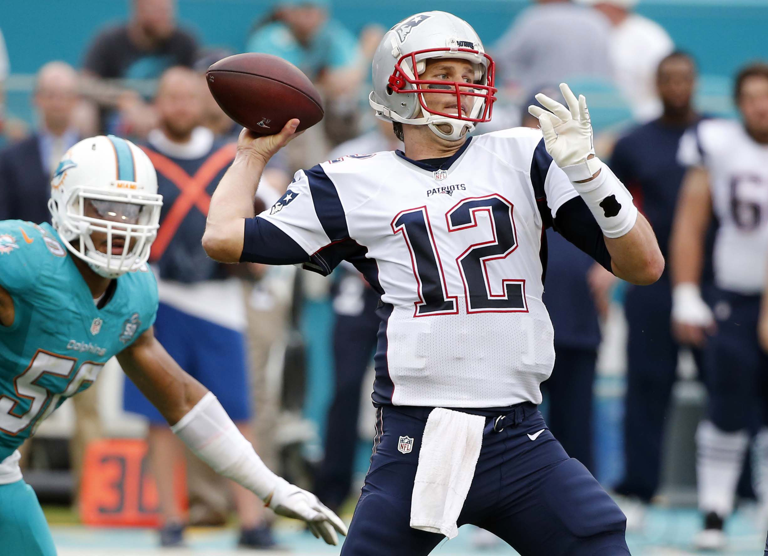 FILE - In this Sunday, Jan. 3, 2016 file photo, New England Patriots quarterback Tom Brady (12) aims to pass during the second half of an NFL football game against the Miami Dolphins in Miami Gardens, Fla. Even after a most unusual season, New England eas