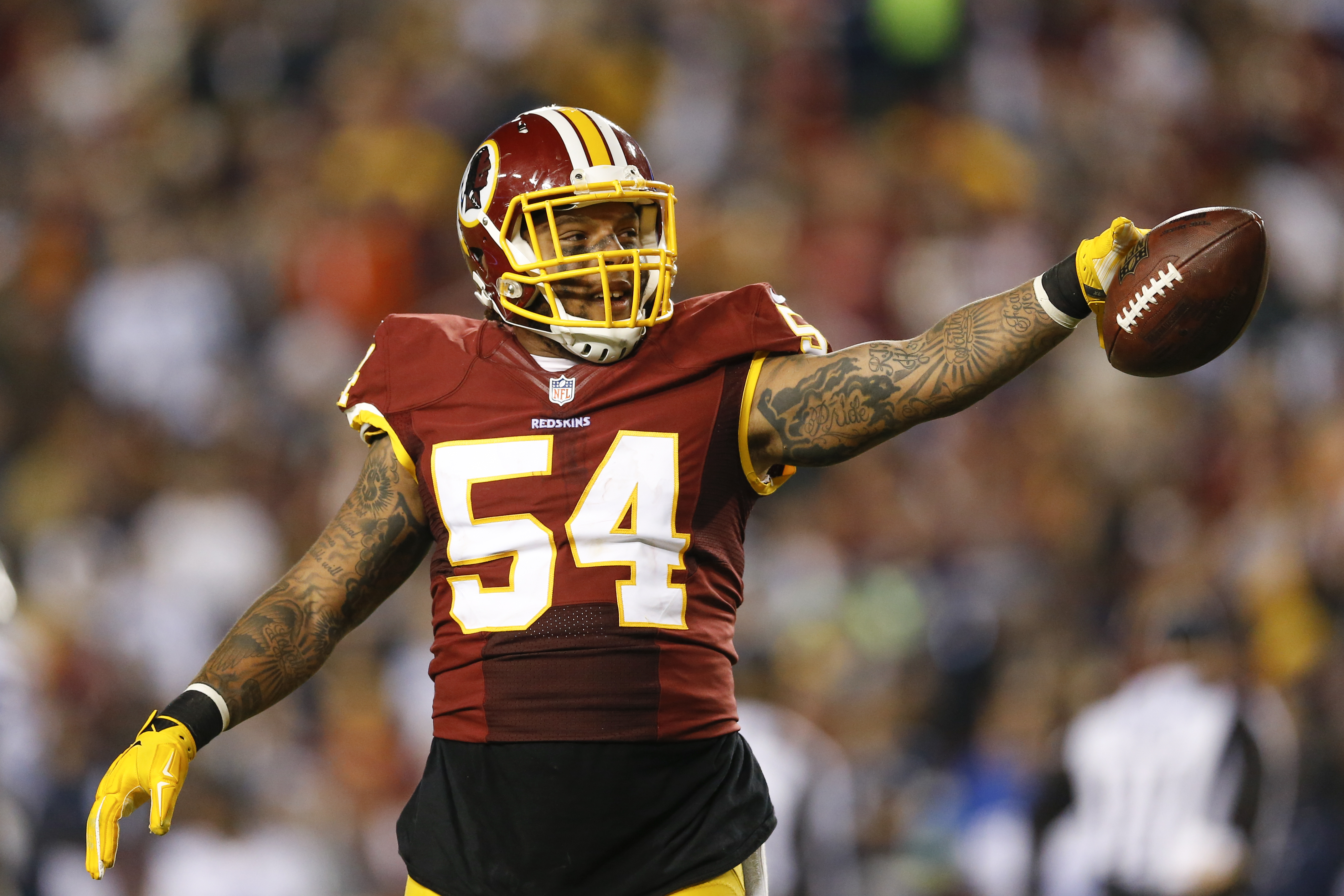 FILE - In this Dec. 7, 2015, file photo, Washington Redskins linebacker Mason Foster celebrates after a play during an NFL football game against the Dallas Cowboys in Landover, Md.  A veteran of more than 50 starts in his first four NFL seasons, linebacke