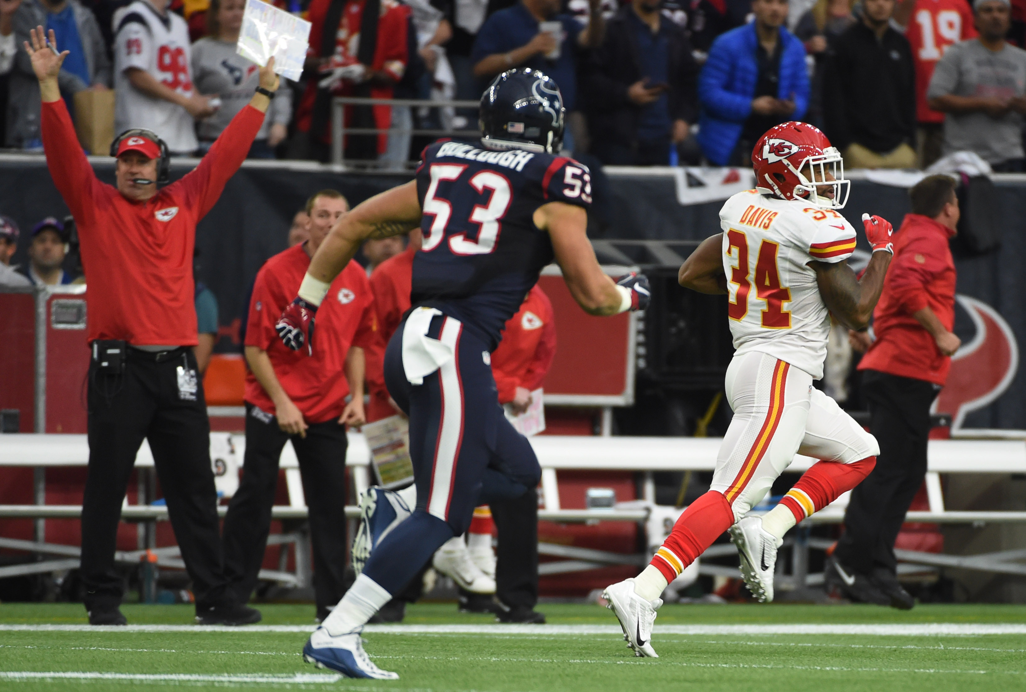 Kansas City Chiefs running back Knile Davis (34) runs for a touchdown as Houston Texans inside linebacker Max Bullough (53) chases him during the first half of an NFL football game Saturday, Jan. 9, 2016, in Houston. (AP Photo/Eric Christian Smith)