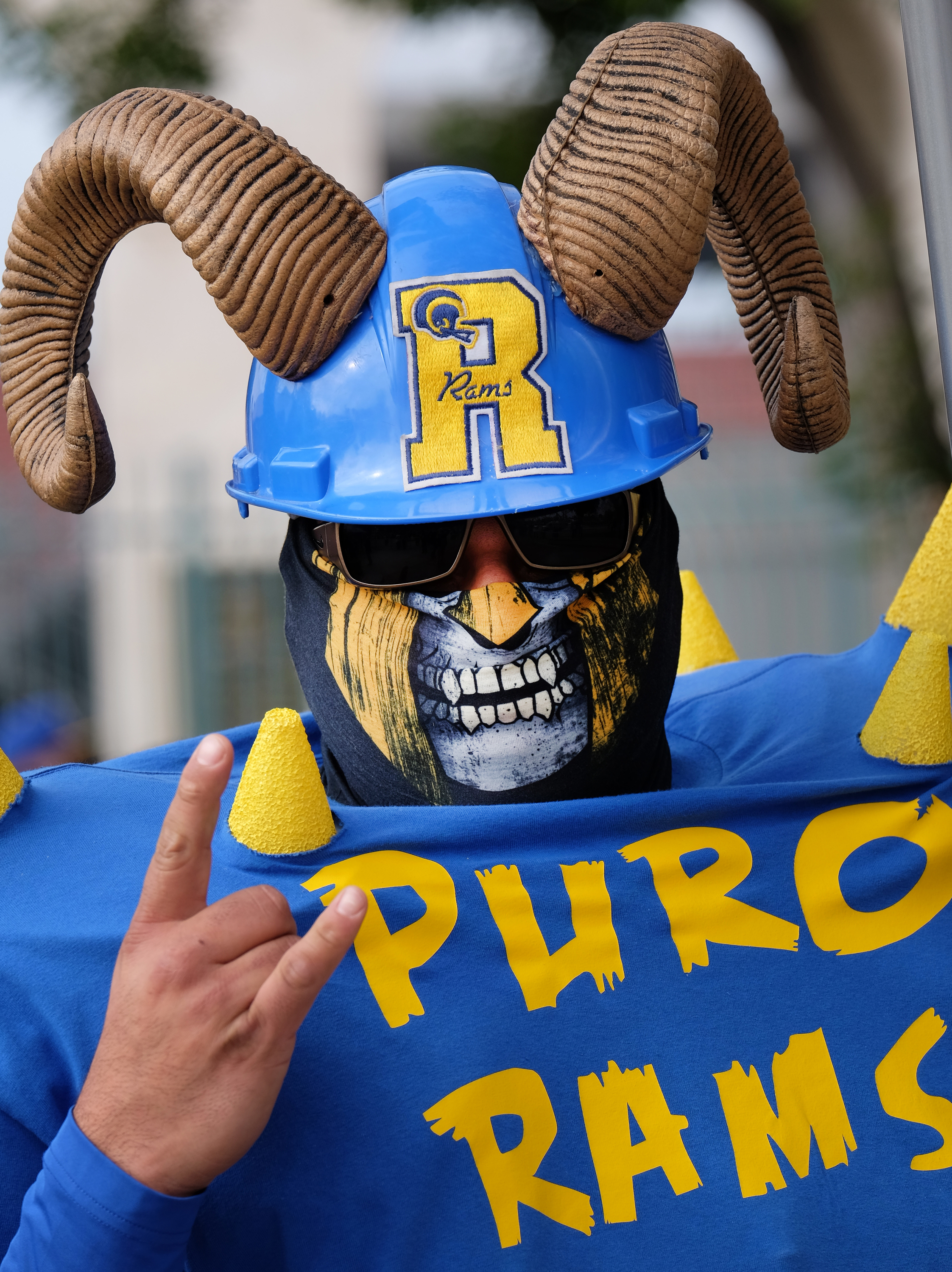 Rams fan Enrique Lopez, arrives for a rally at the historic Los Angeles Memorial Coliseum. Saturday, Jan. 9, 2016 in Los Angeles. Boisterous Los Angeles Rams fans gathered Saturday to herald the NFL football team's possibly imminent return to Southern Cal