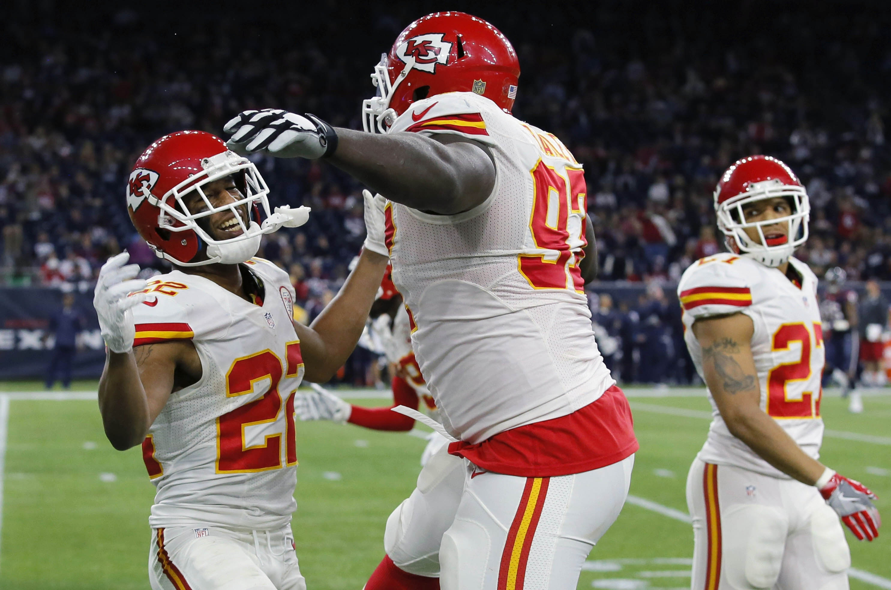 Kansas City Chiefs defensive back Tyvon Branch (27) and defensive end Allen Bailey (97) celebrate against the Houston Texans during the second half of an NFL wild-card playoff football game Saturday, Jan. 9, 2016, in Houston. (AP Photo/Tony Gutierrez)