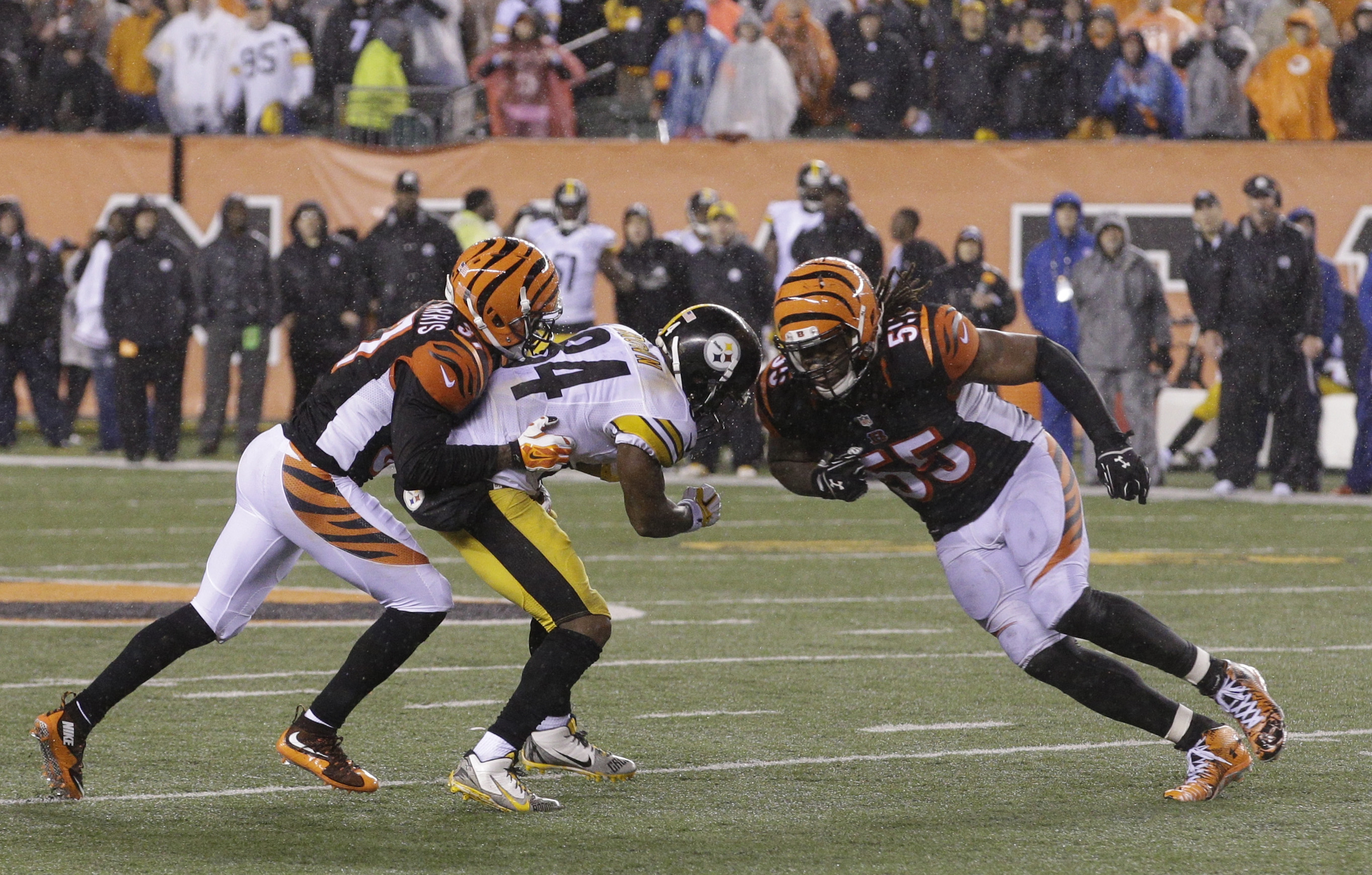 Cincinnati Bengals' Vontaze Burfict (55) runs into Pittsburgh Steelers' Antonio Brown (84) during the second half of an NFL wild-card playoff football game Sunday, Jan. 10, 2016, in Cincinnati. Pittsburgh won 18-16. Burfict was called for a penalty on the