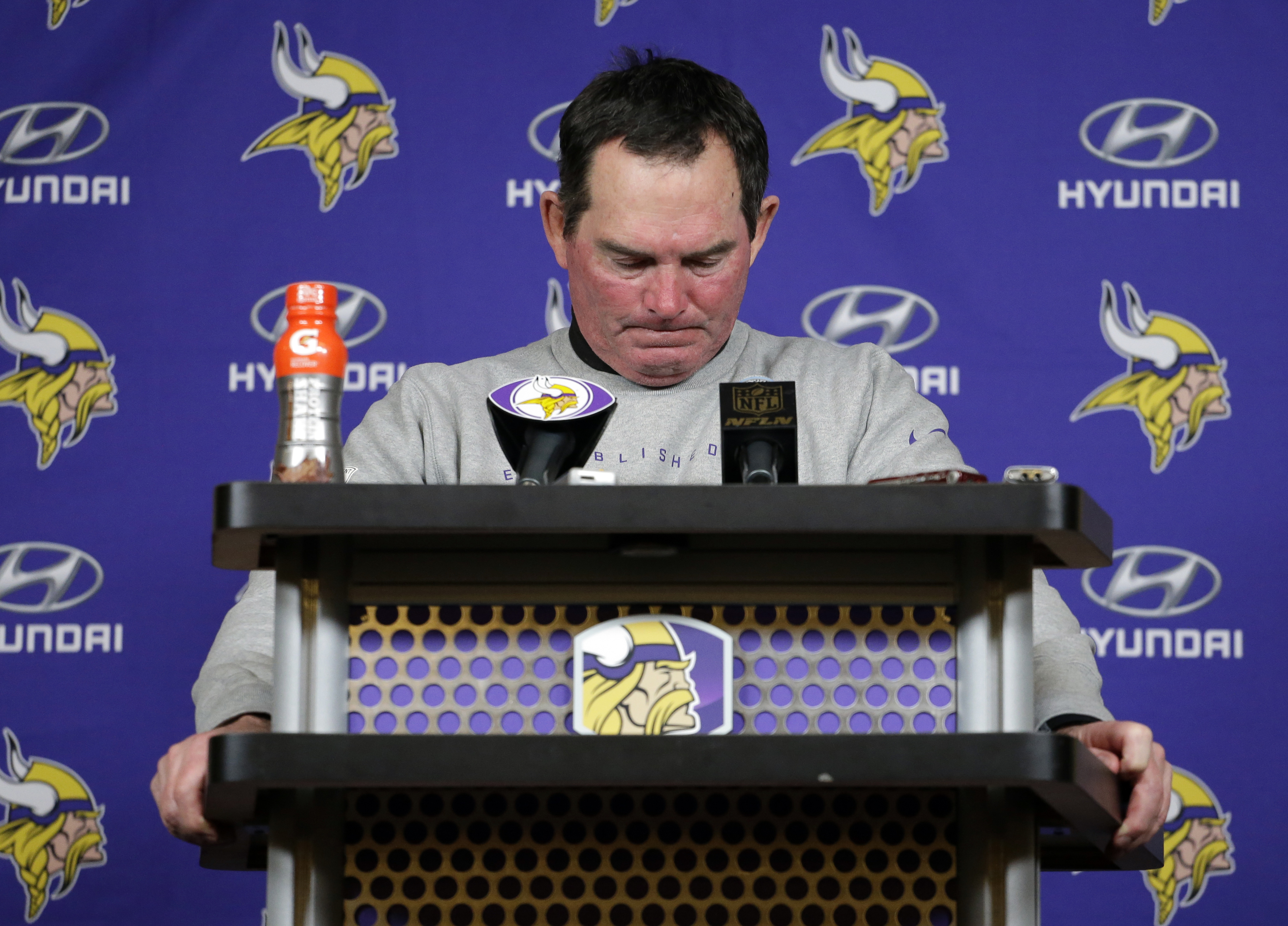 Minnesota Vikings head coach Mike Zimmer pauses during a post game news conference after an NFL wild-card football game against the Seattle Seahawks, Sunday, Jan. 10, 2016, in Minneapolis. The Seahawks won 10-9. (AP Photo/Nam Y. Huh)