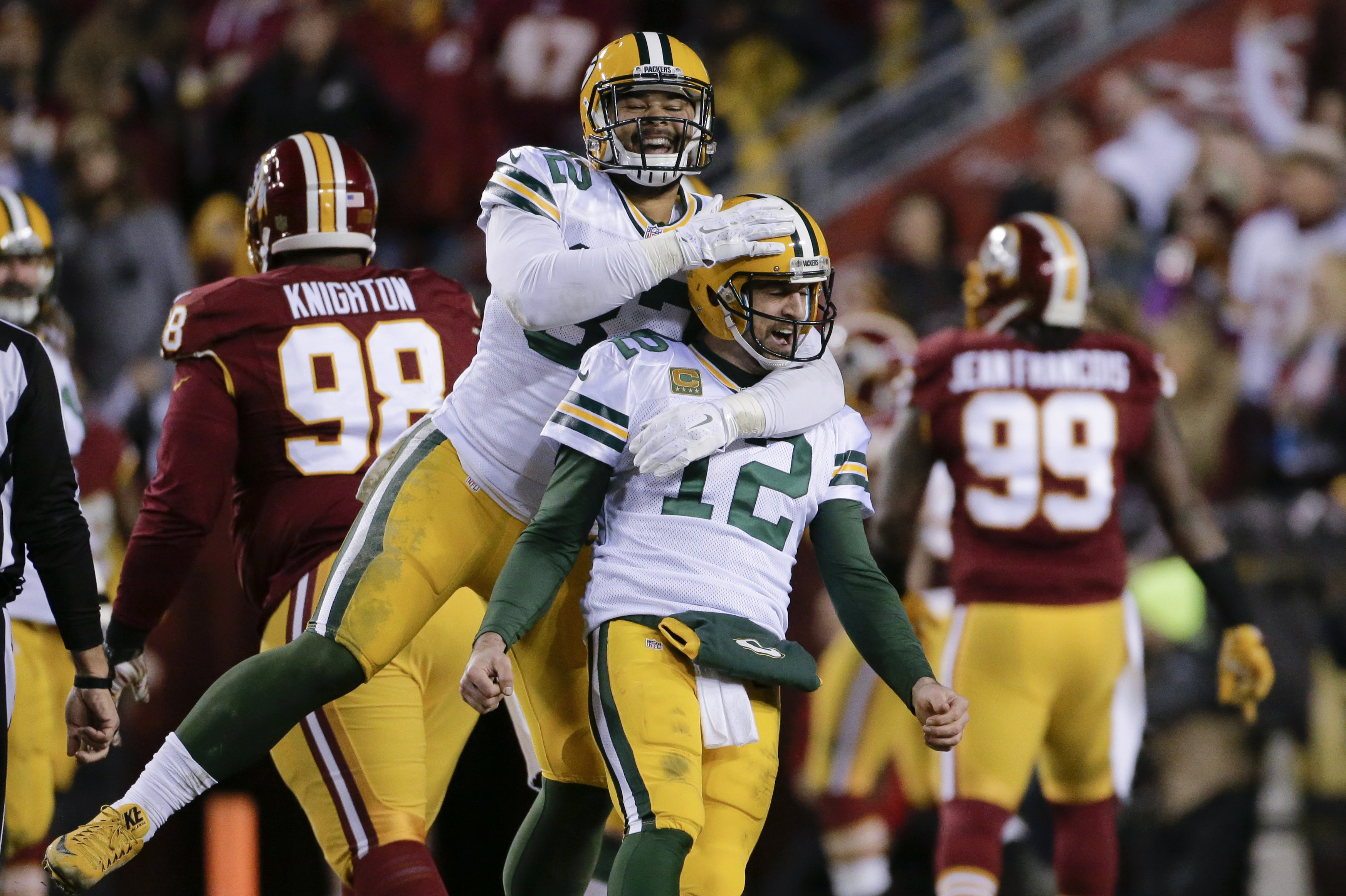 Green Bay Packers tight end Richard Rodgers (82) celebrates with quarterback Aaron Rodgers (12) after wide receiver Davante Adams caught a touchdown pass during the first half of an NFL wild-card playoff football game against the Washington Redskins in La