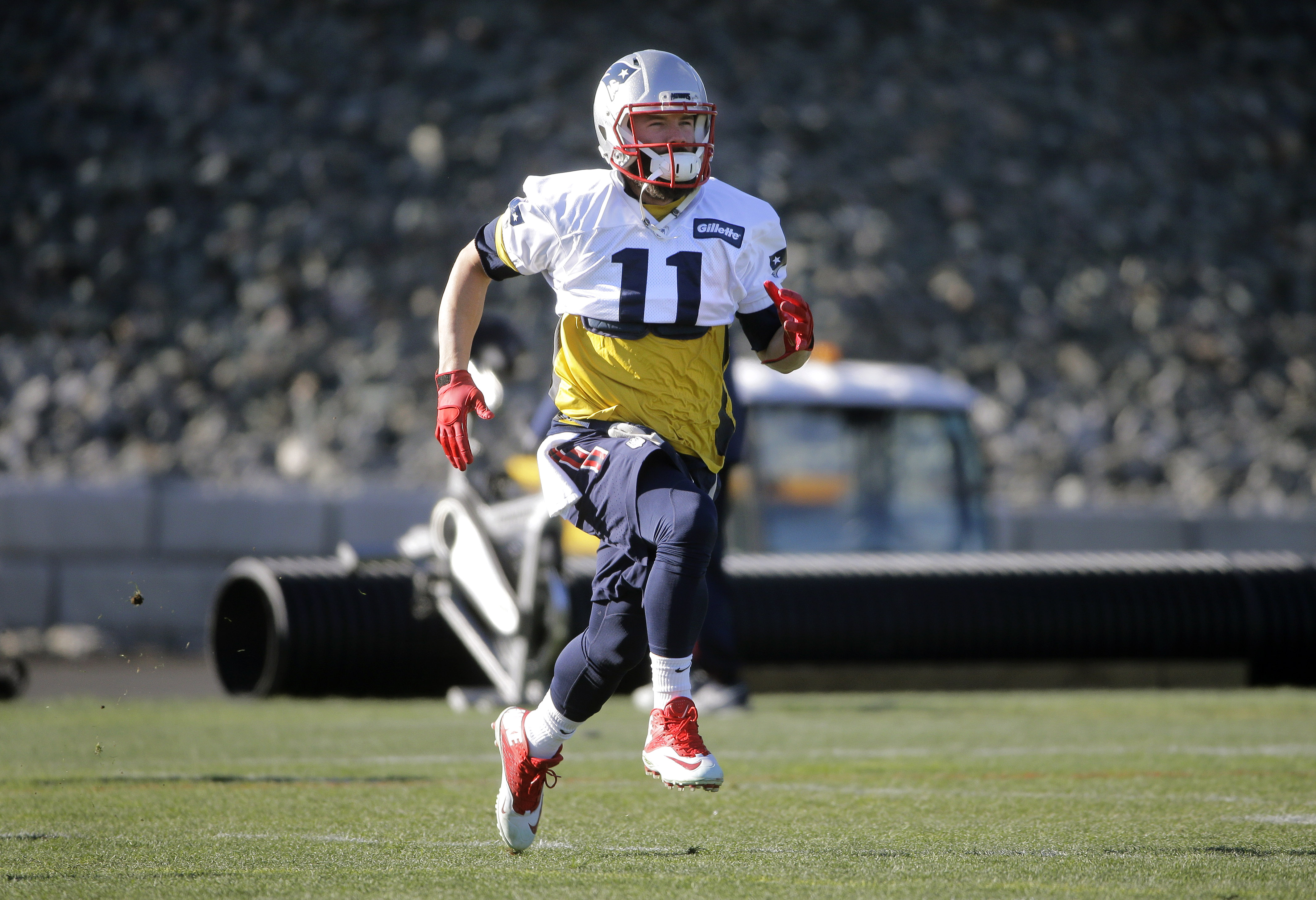 New England Patriots wide receiver Julian Edelman runs while warming up on the field during an NFL football practice, Monday, Jan. 11, 2016, in Foxborough, Mass. The Patriots are to host the Kansas City Chiefs in an NFL divisional playoff game Jan. 16, in