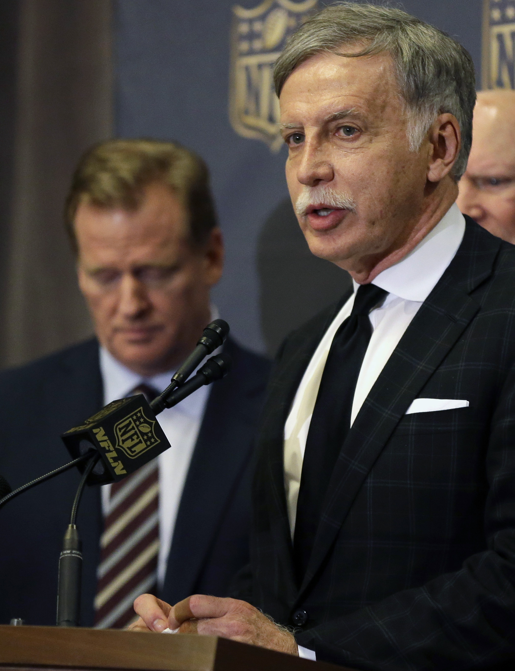 NFL Commissioner Roger Goodell, left, looks down as St. Louis Rams owner Stan Kroenke talks to the media after team owners voted Tuesday, Jan. 12, 2016, in Houston to allow the Rams to move to a new stadium just outside Los Angeles, and the San Diego Char
