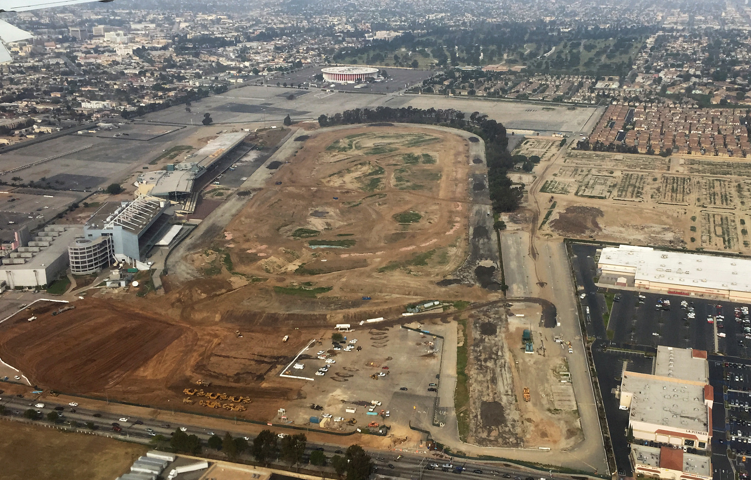 FILE - In this Feb. 20, 2015, aerial file photo taken from the window of a commercial airliner, the site of the former Hollywood Park horse-racing track stands in Inglewood, Calif. NFL owners voted Tuesday night, Jan. 12, 2016, to allow the St. Louis Rams