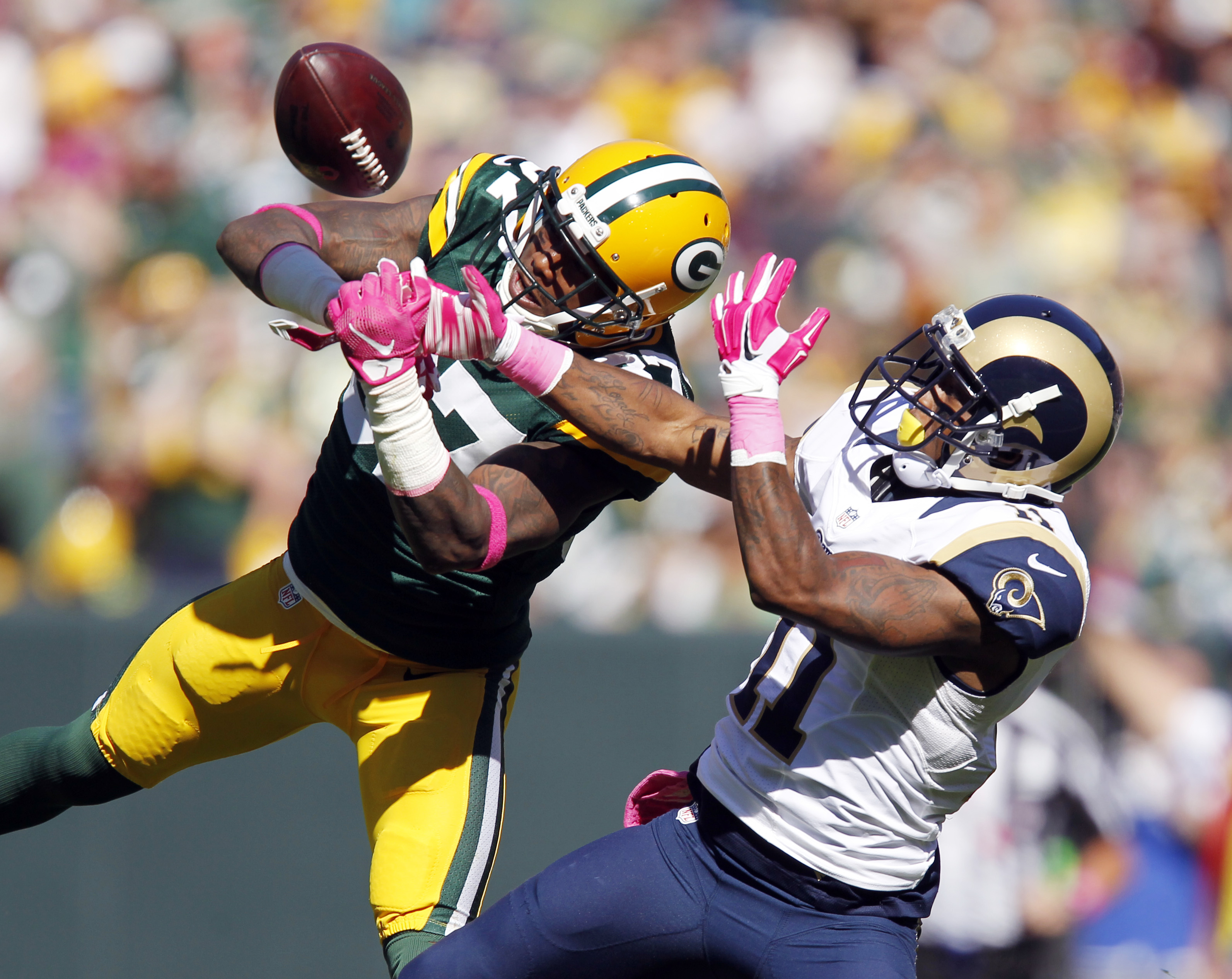 FILE - In this Oct. 11, 2015, file photo, Green Bay Packers' Sam Shields breaks up a pass intended for St. Louis Rams' Tavon Austin during the first half an NFL football game, in Green Bay, Wis. Cardinals quarterback Carson Palmer thinks he's got the fast