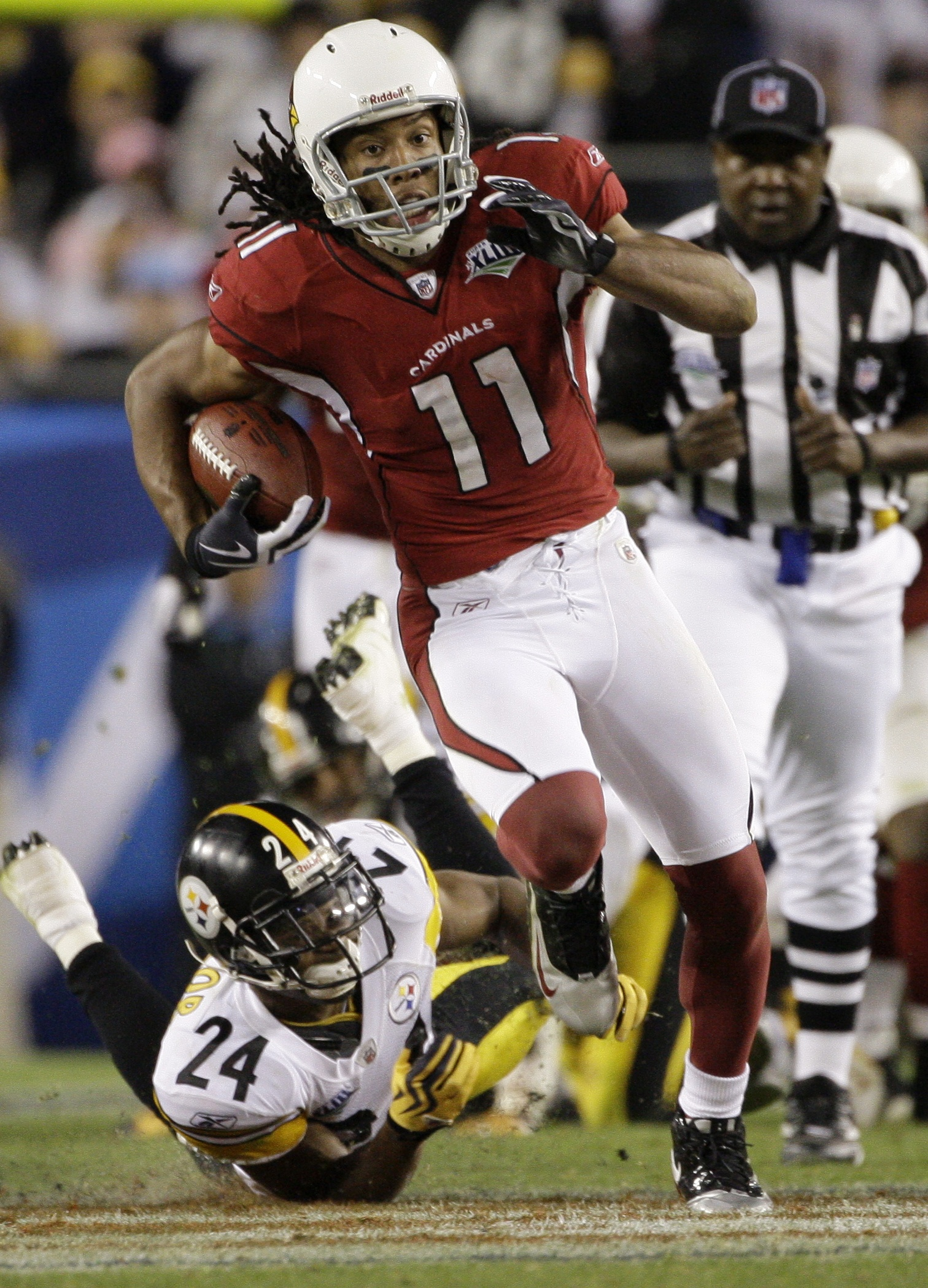 FILE - In this Feb. 1, 2009, file photo, Arizona Cardinals wide receiver Larry Fitzgerald (11) runs past Pittsburgh Steelers cornerback Ike Taylor (24) for a 64-yard touchdown reception during the fourth quarter of the NFL Super Bowl XLIII football game,