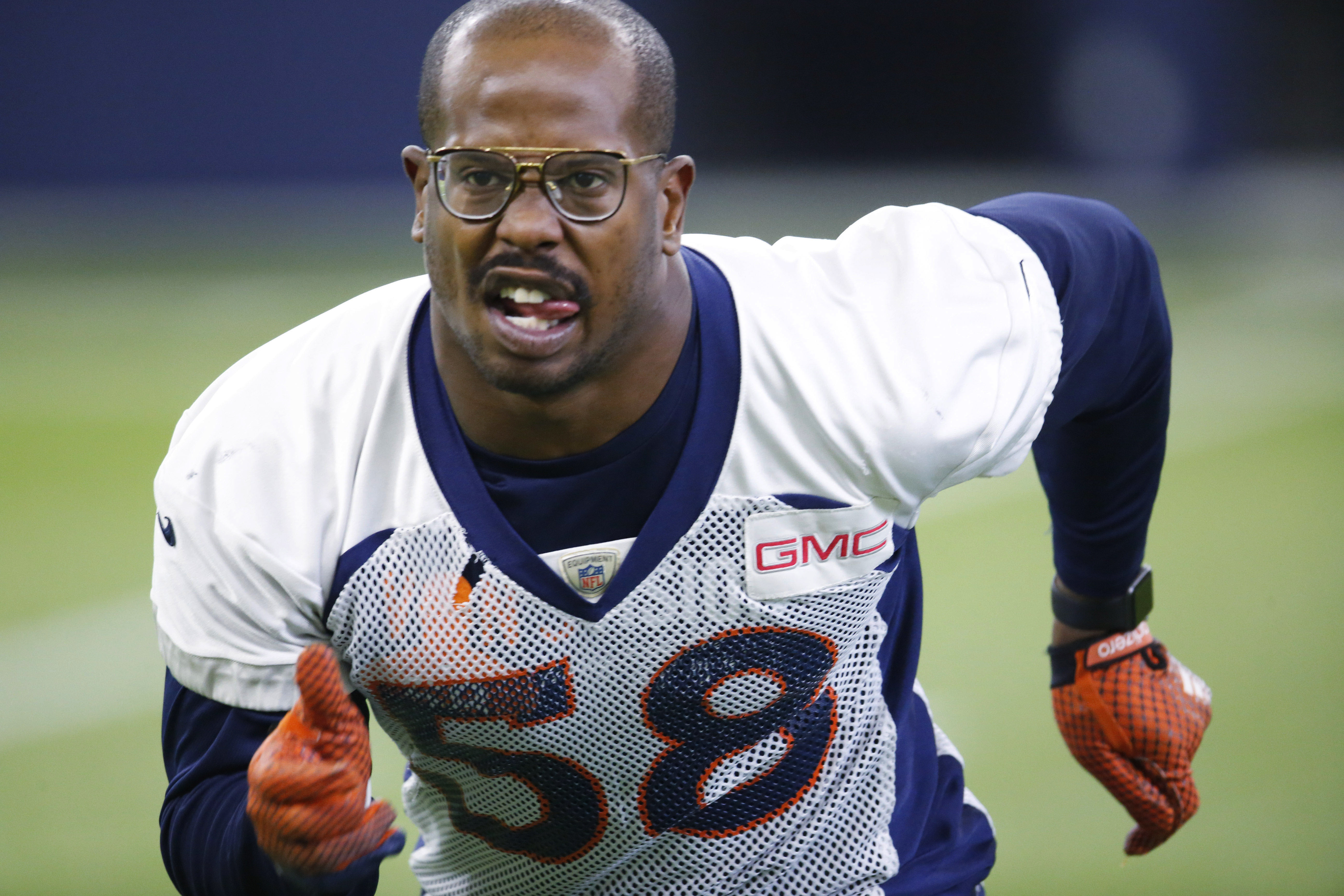 FILE - In this Jan. 7, 2016, file photo, Denver Broncos outside linebacker Von Miller takes part in drill during the team's NFL football practice in Englewood, Colo. Miller returned to practice Thursday, Jan. 14, after suffering from a bout of food poison