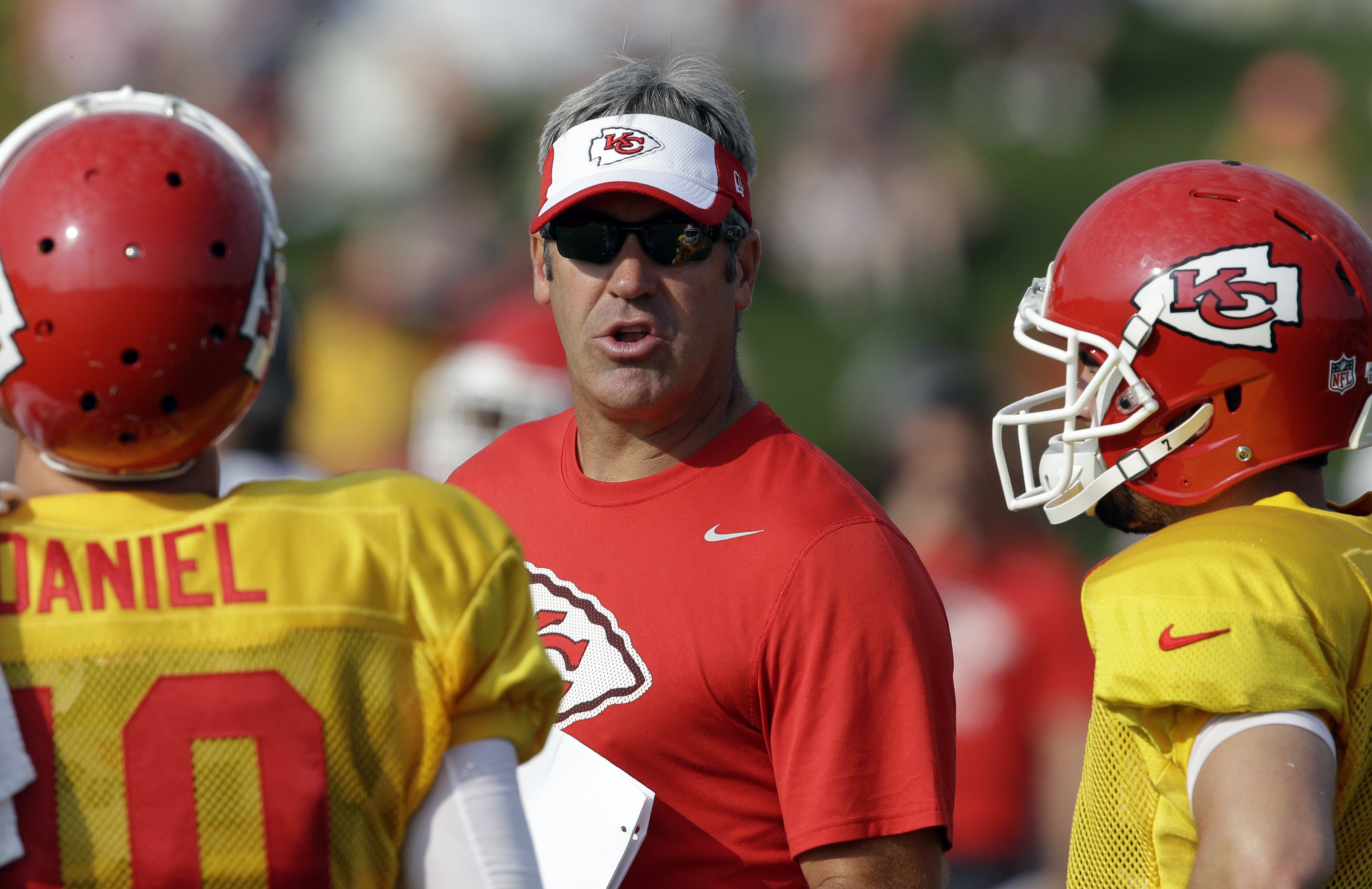 FILE - In this Aug. 4, 2015, file photo, Kansas City Chiefs offensive coordinator Doug Pederson, center, attends NFL football training camp in St. Joseph, Mo. Pederson has accepted an offer to become the Philadelphia Eagles coach, a person with knowledge
