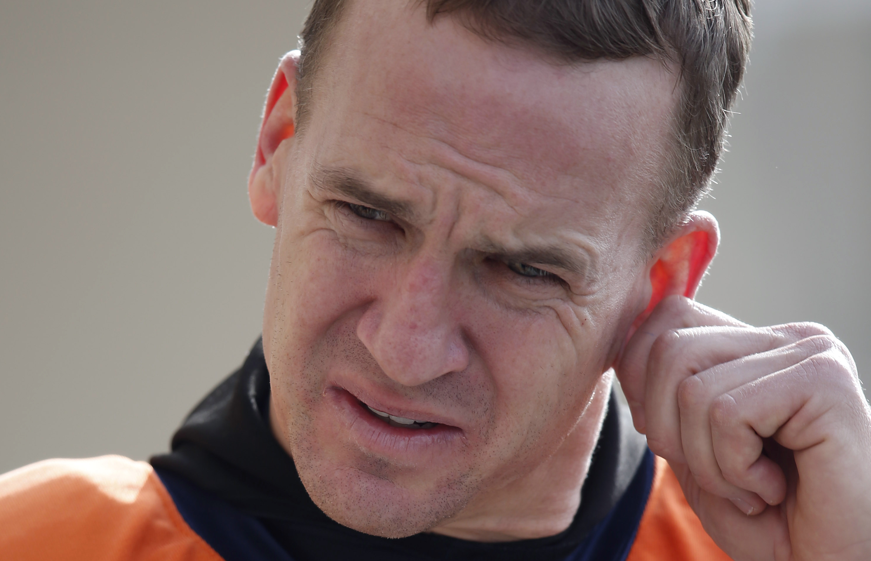 FILE - In this Jan. 13, 2016, file photo, Denver Broncos quarterback Peyton Manning heads to news conference after the team's NFL football practice, at the Broncos' headquarters in Englewood, Colo. No one ever really rooted against Peyton Manning, but boy