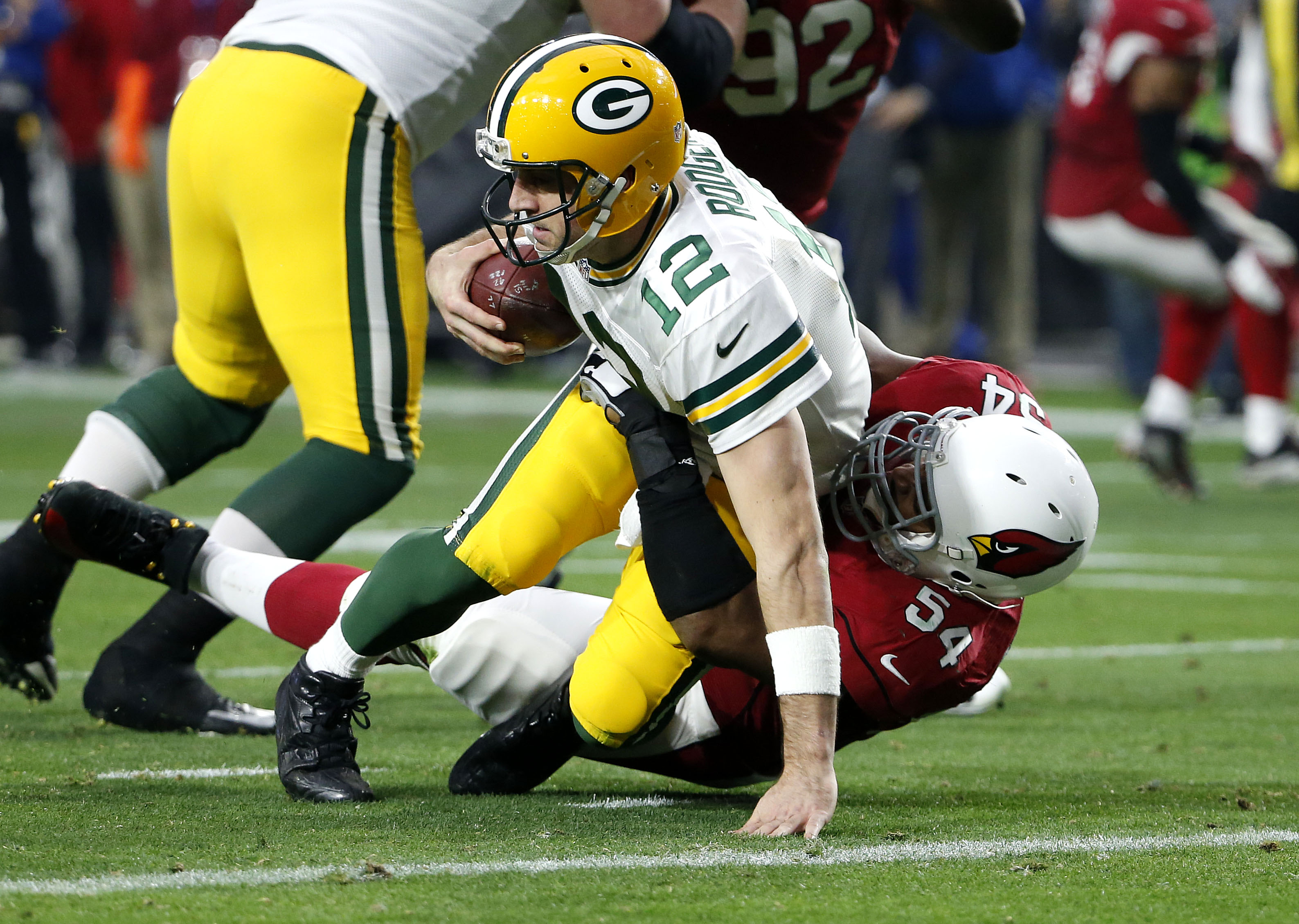 FILE - In this Dec. 27, 2015, file photo, Green Bay Packers quarterback Aaron Rodgers (12) is sacked by Arizona Cardinals inside linebacker Dwight Freeney during the second half of an NFL football game, in Glendale, Ariz. Three weeks ago, the Arizona Card