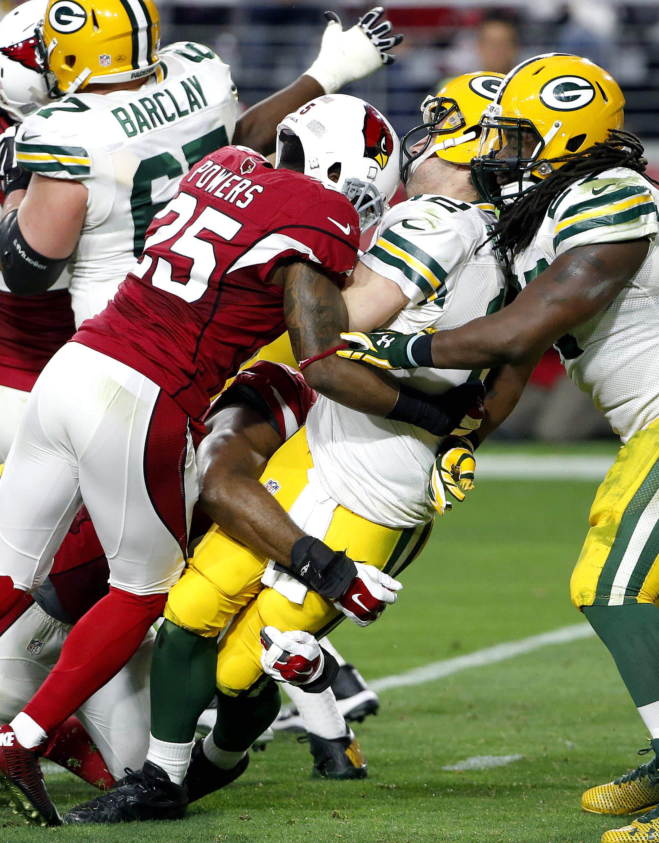 FILE - In this Dec. 27, 2015, file photo, Green Bay Packers quarterback Aaron Rodgers (12) is sacked by Arizona Cardinals cornerback Jerraud Powers (25) during the second half of an NFL football game, in Glendale, Ariz. Three weeks ago, the Arizona Cardin